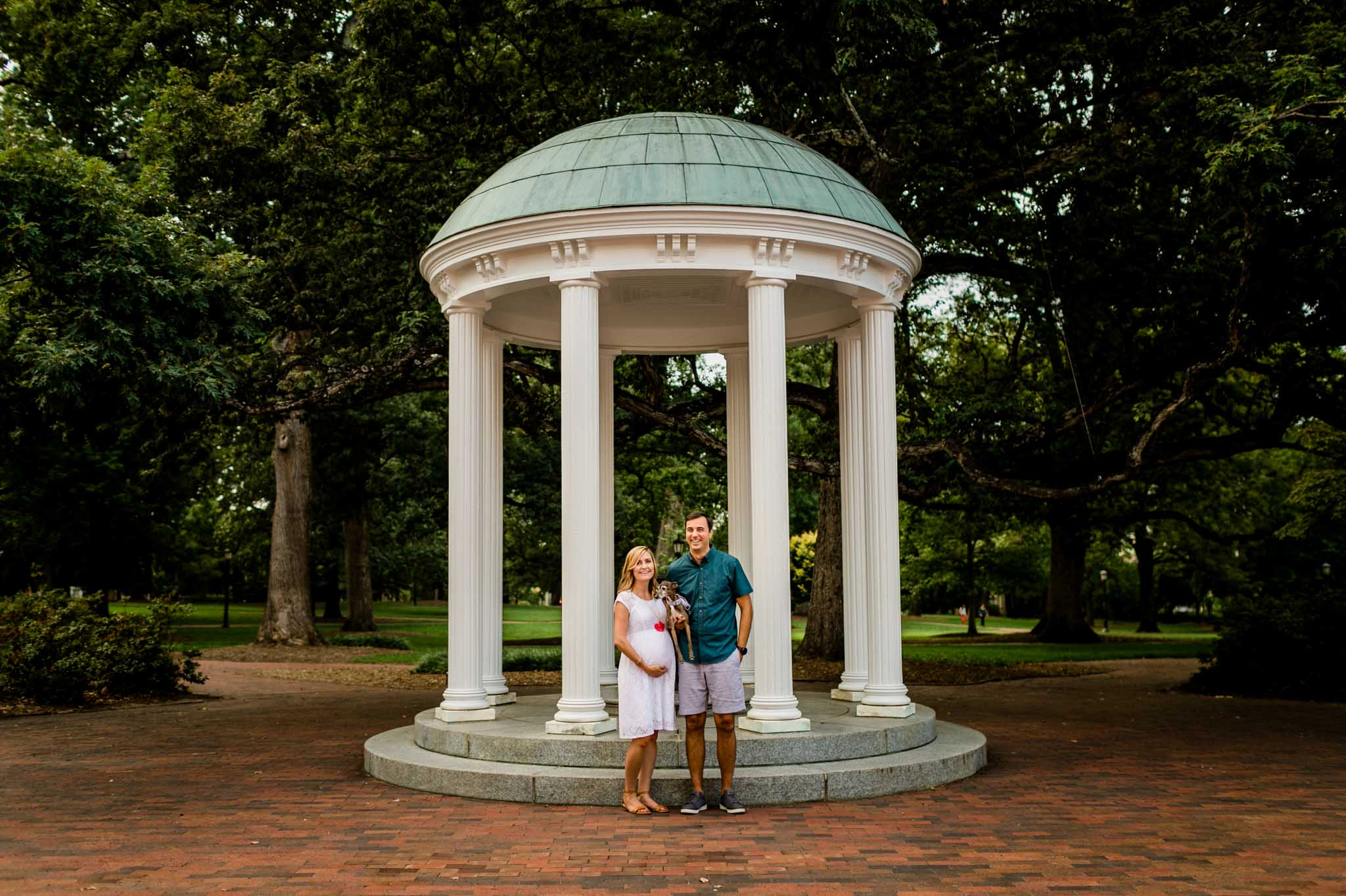 UNC Chapel Hill Maternity Photography | By G. Lin Photography | Couple standing by the Old Well