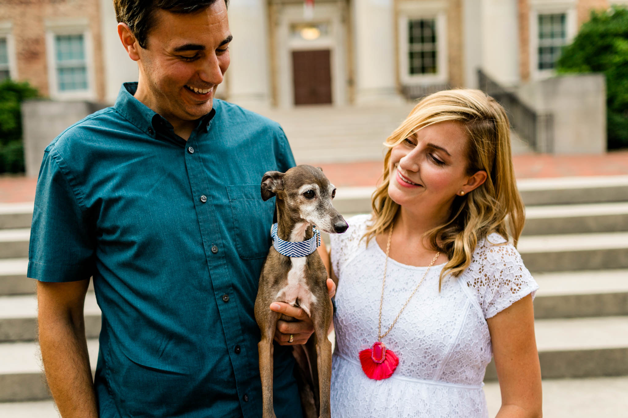 Chapel Hill Maternity Photographer at UNC | By G. Lin Photography | Couple holding dog in front of South Building