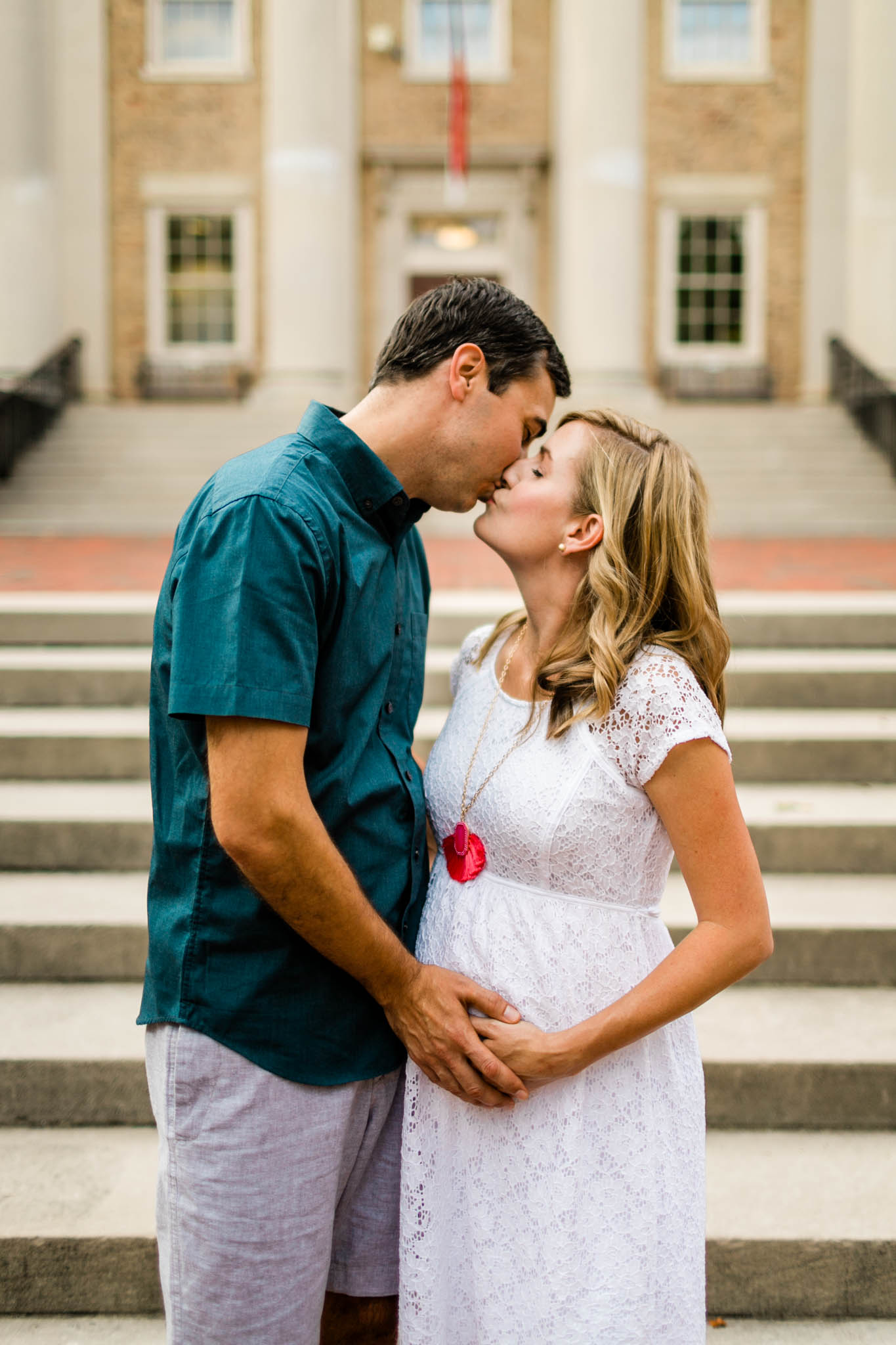 Maternity Photography at UNC Campus | By G. Lin Photography | South Building | Couple kissing