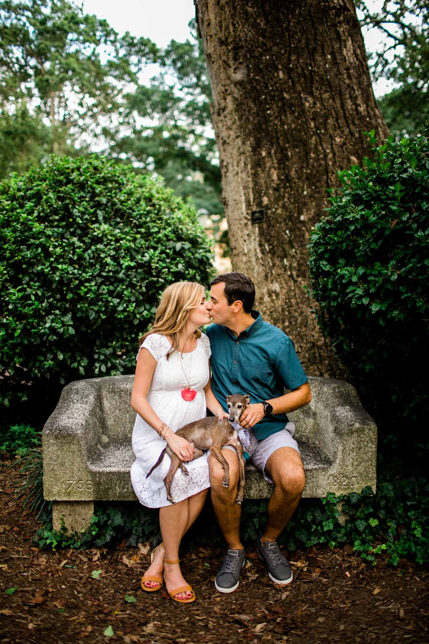 Davie Bench at UNC | By G. Lin Photography | Couple kissing on Davie Bench at UNC