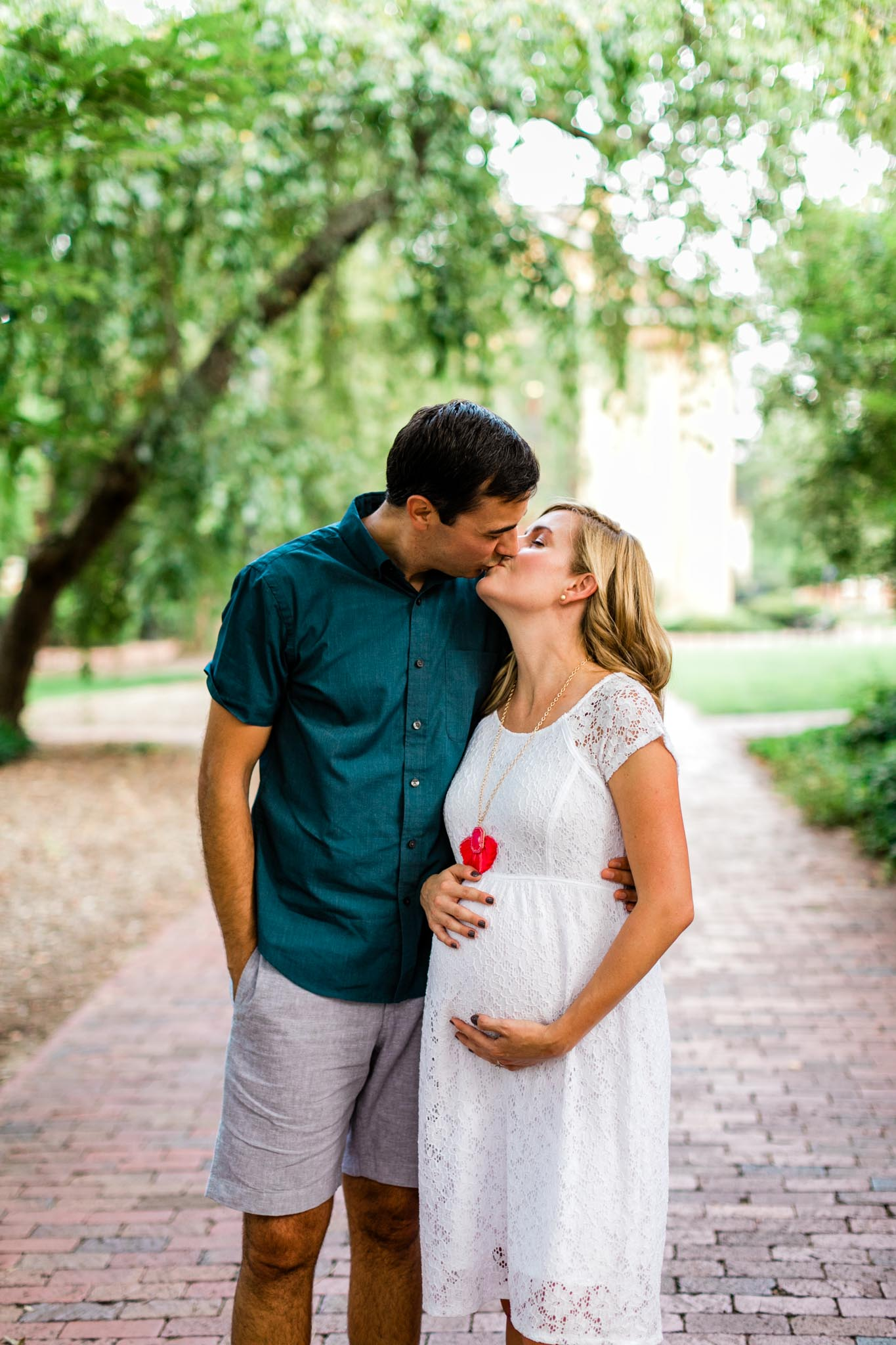 Couple kissing at McCorkle Place UNC | Chapel Hill Maternity Photographer | By G. Lin Photography