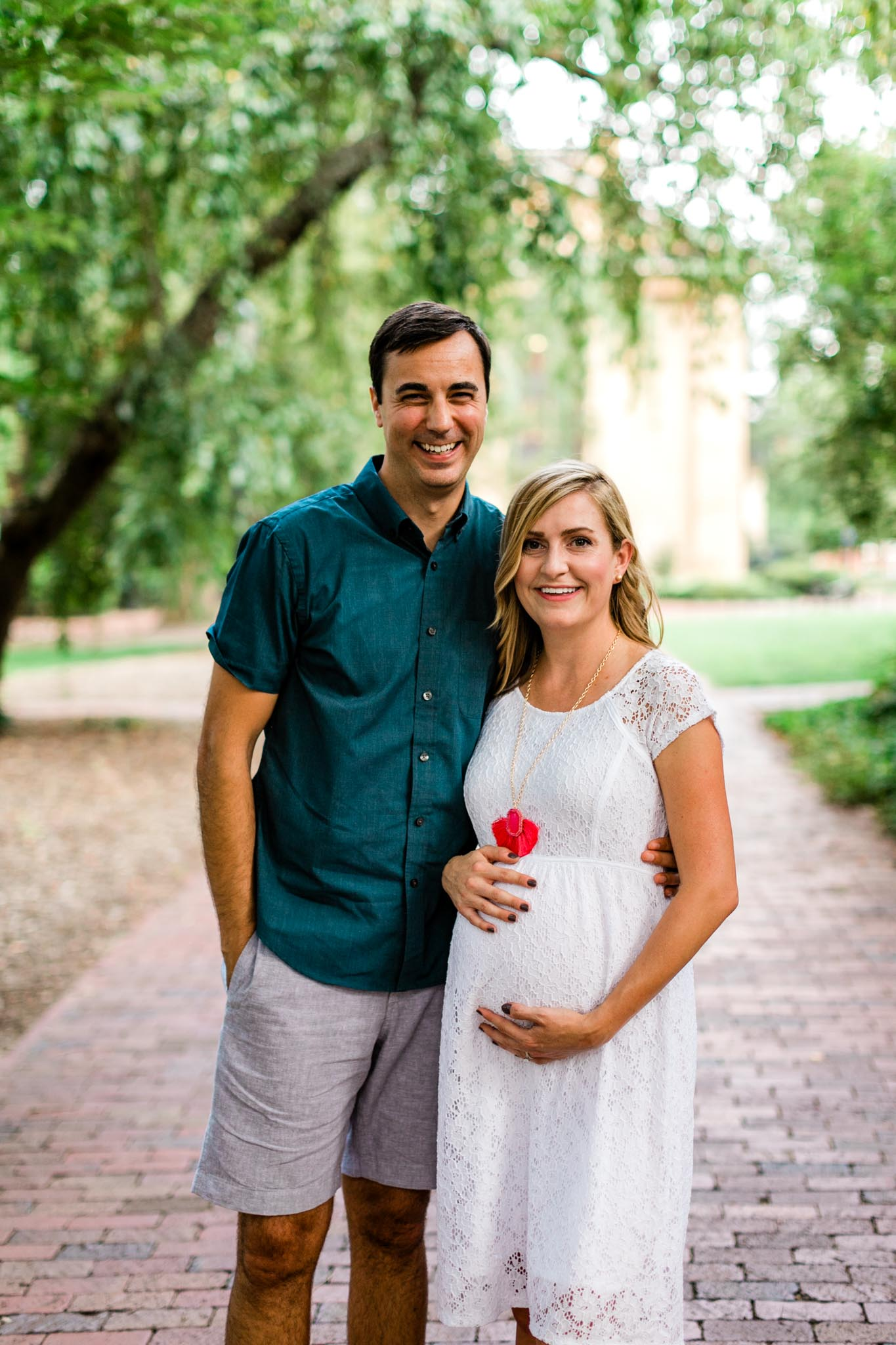 Maternity portrait of couple at McCorkle Place at UNC | By G. Lin Photography | Chapel Hill Maternity Photographer