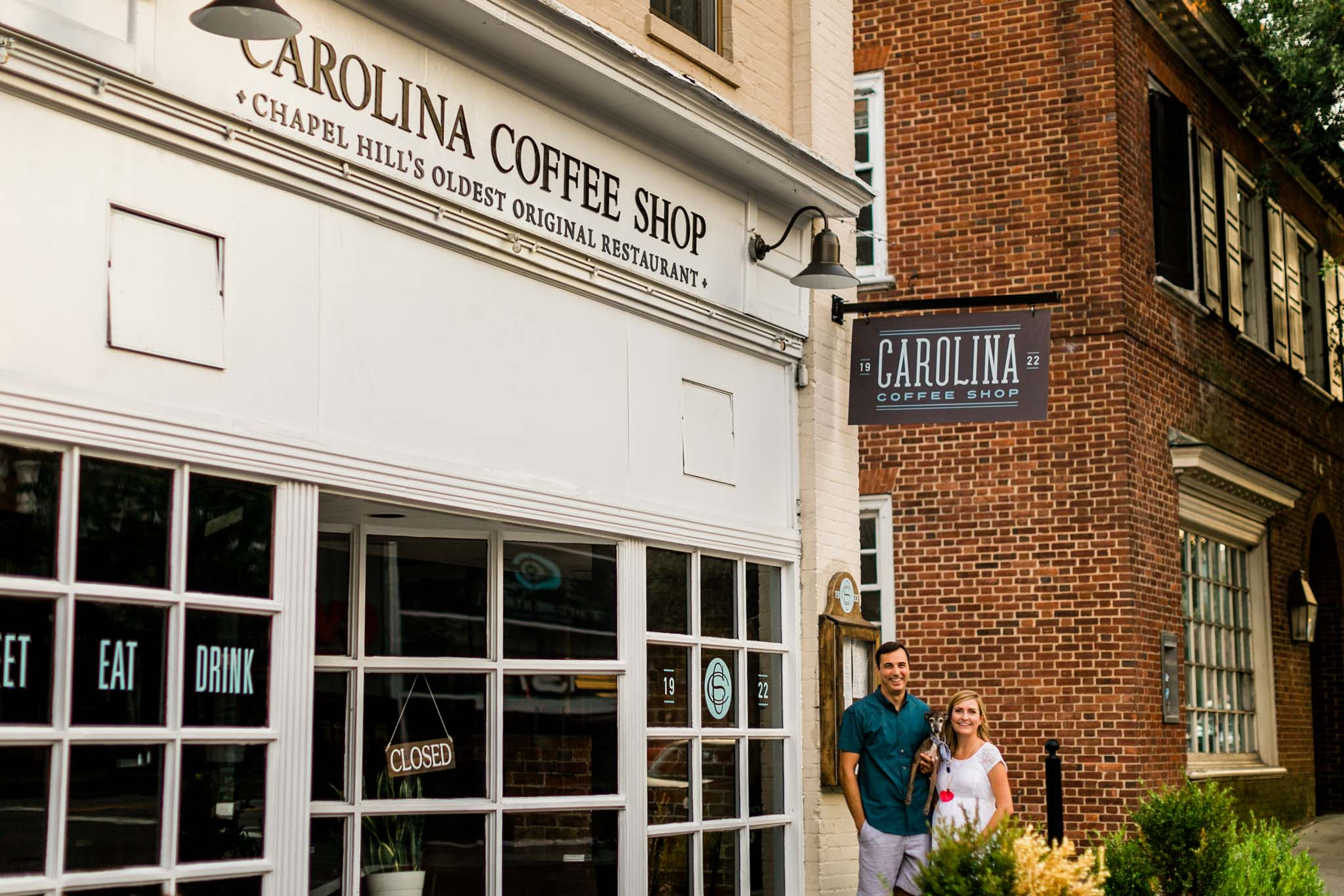 Couple standing in front of coffee shop at UNC | Chapel Hill Photographer | By G. Lin Photography