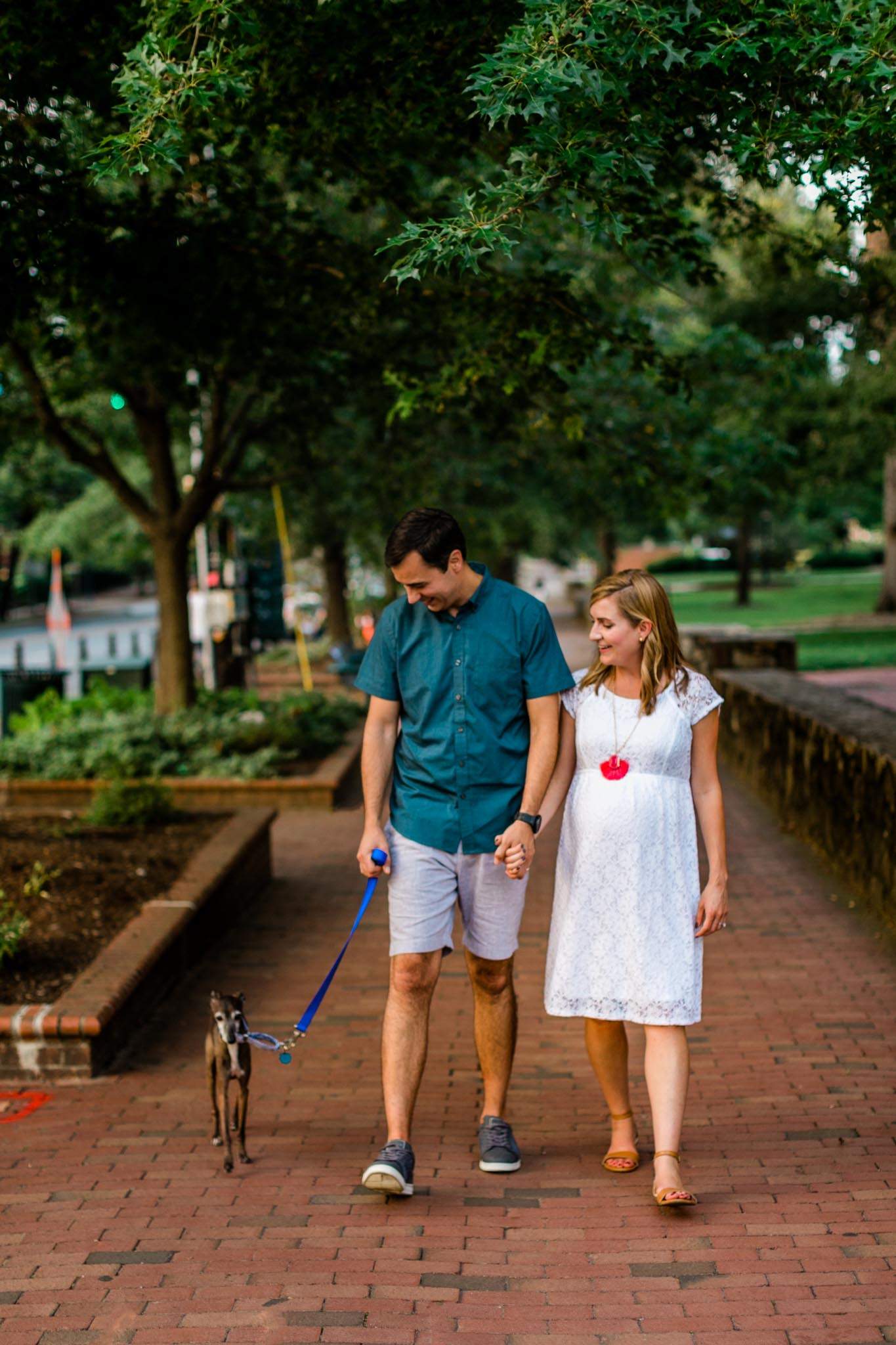 UNC Chapel Hill Photographer | By G. Lin Photography | Couple holding hands and walking down Franklin Street
