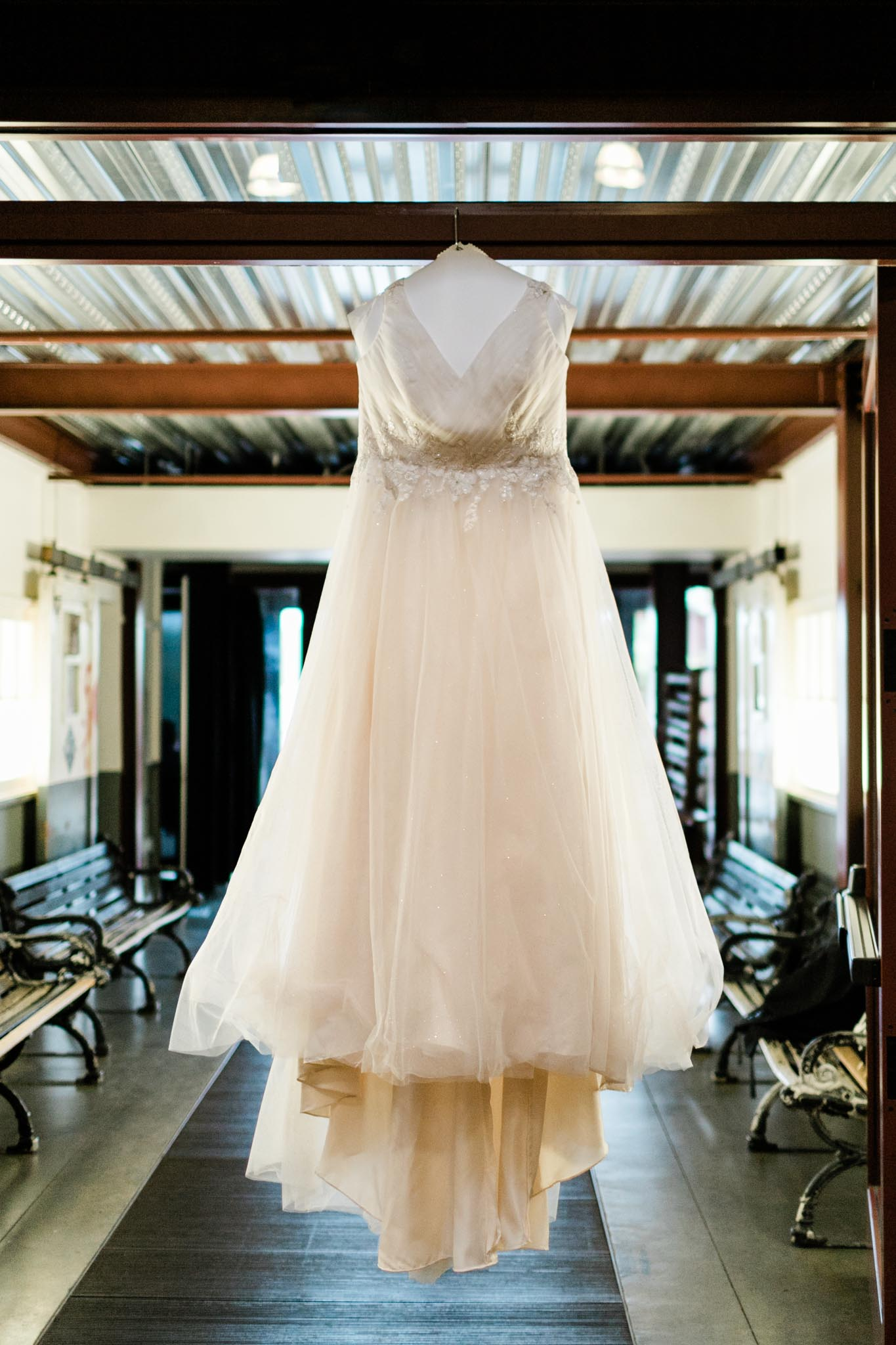 Haw River Ballroom Wedding | Durham Photographer | By G. Lin Photography | Wedding Dress hanging on doorway