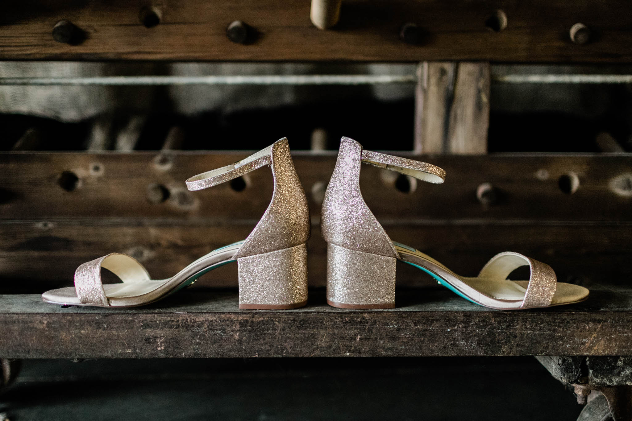 Haw River Ballroom Wedding | Durham Photographer | By G. Lin Photography | Wedding Shoes on wooden shelf