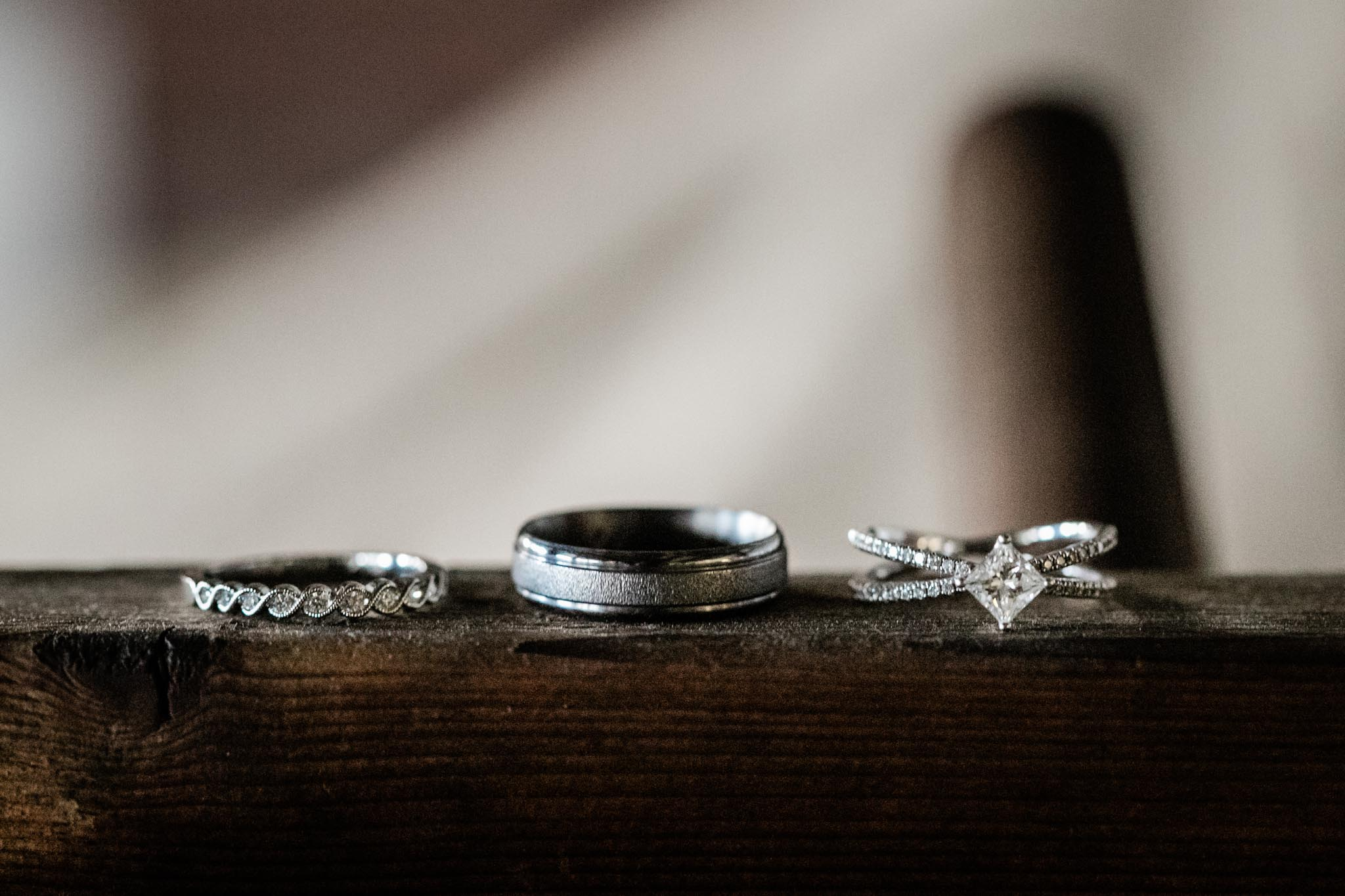 Haw River Ballroom Wedding | Durham Photographer | By G. Lin Photography | Wedding rings close up on wooden shelf