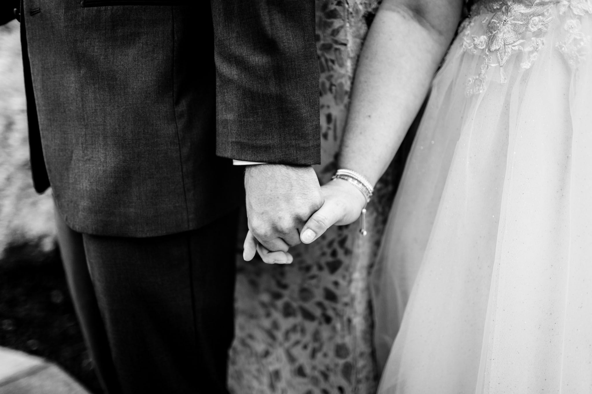 Haw River Ballroom Wedding | Durham Photographer | By G. Lin Photography | Black and white photo of bride and groom holding hands