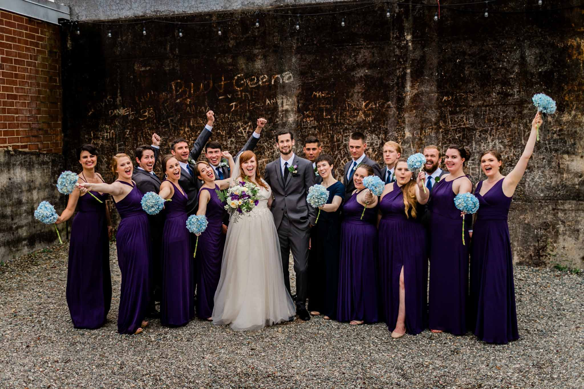 Haw River Ballroom Wedding | Durham Photographer | By G. Lin Photography | Wedding party outside of amphitheater cheering