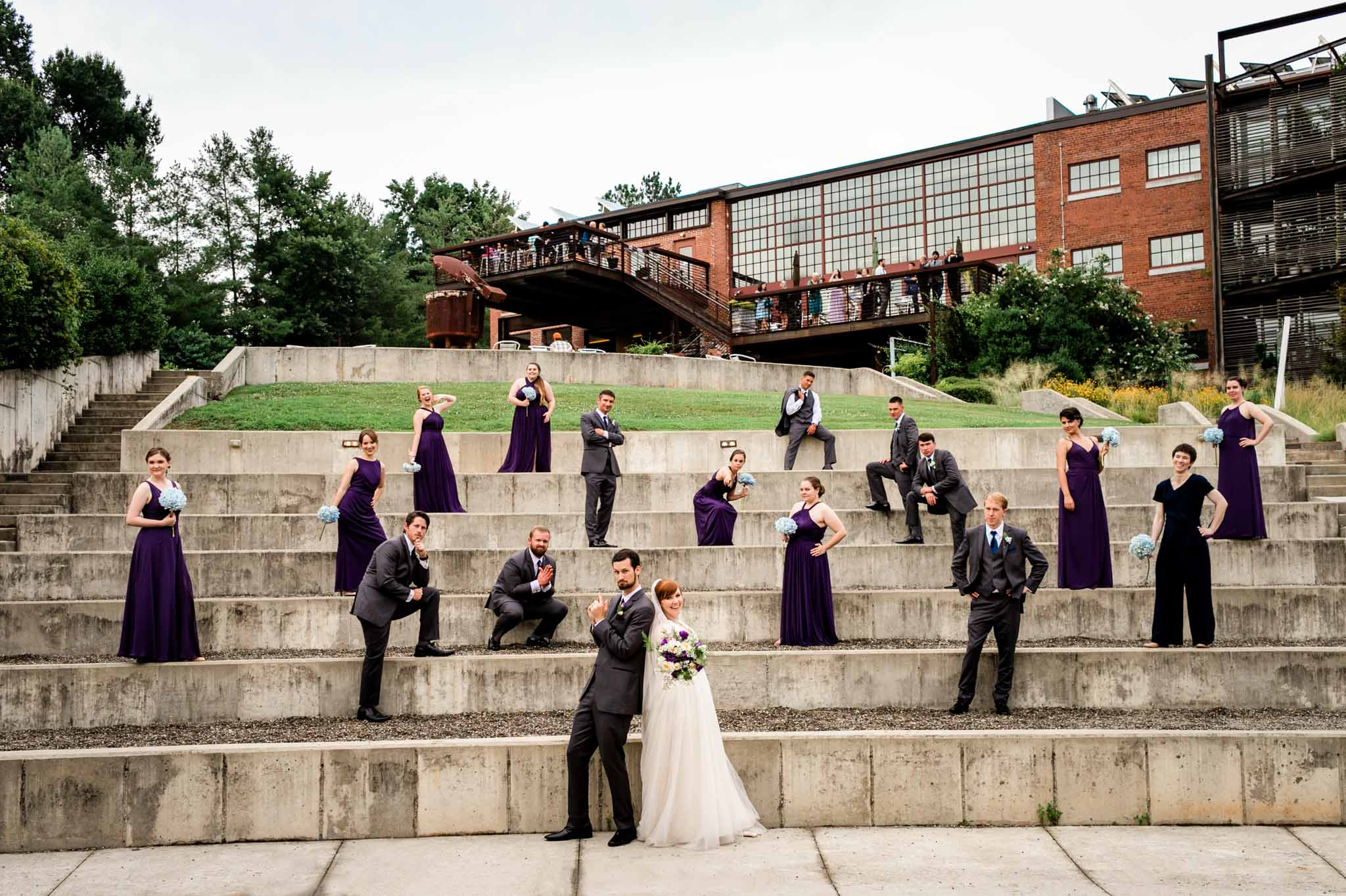 Haw River Ballroom Wedding | Durham Photographer | By G. Lin Photography | Wedding party posing outside at amphitheater