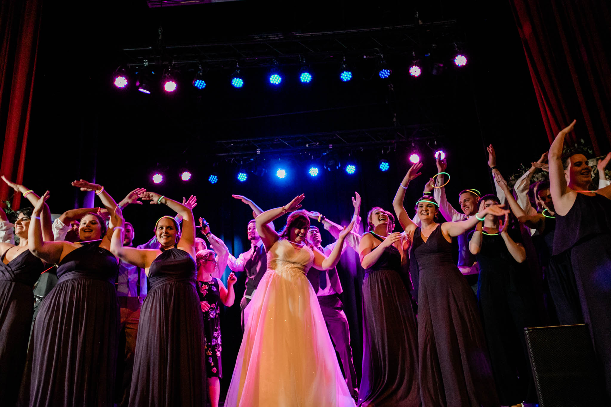 Haw River Ballroom Wedding | Durham Wedding Photographer | By G. Lin Photography | Bridesmaids dancing YMCA on stage