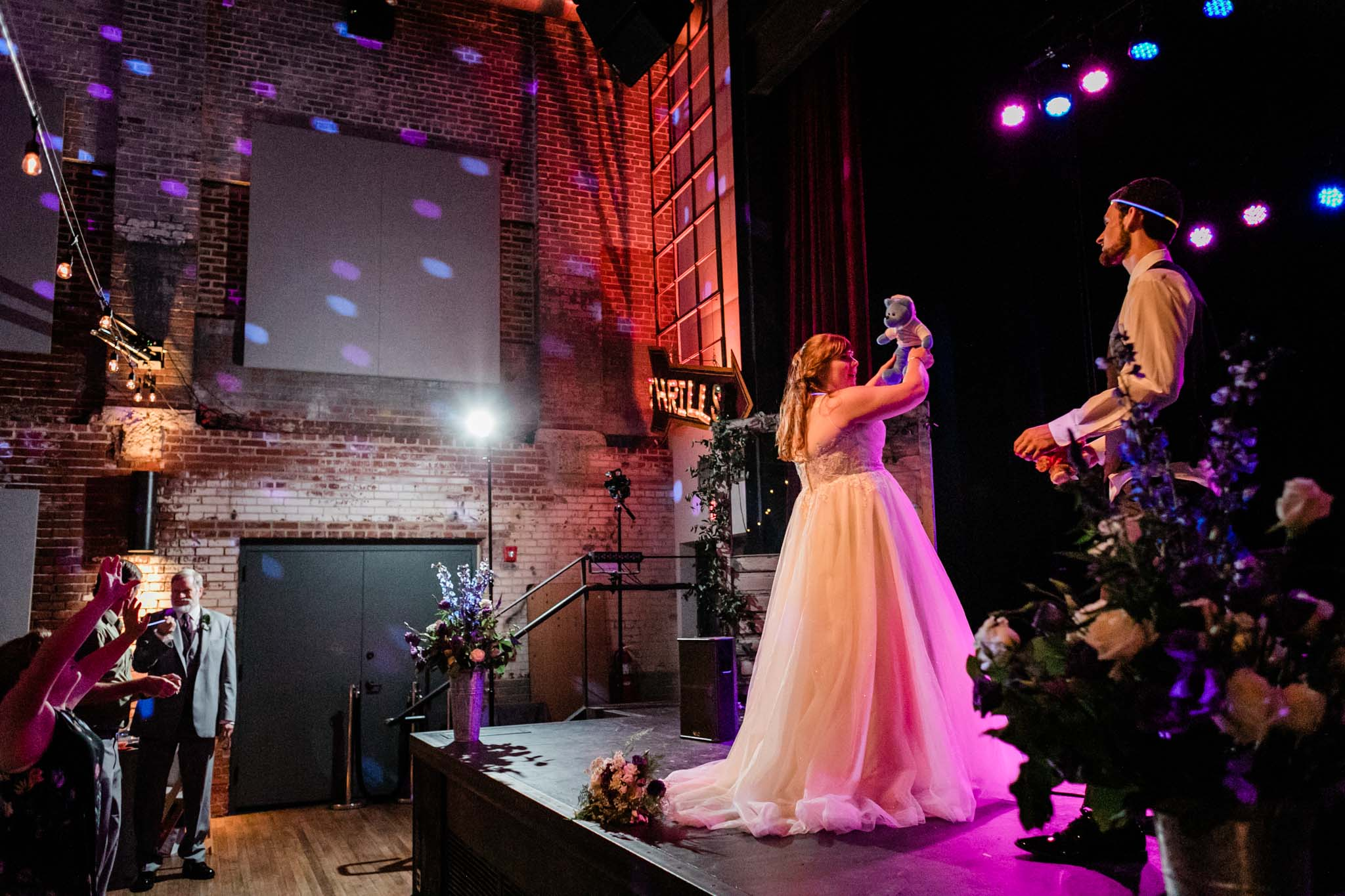 Haw River Ballroom Wedding | Durham Photographer | By G. Lin Photography | Bride tossing bear towards crowd