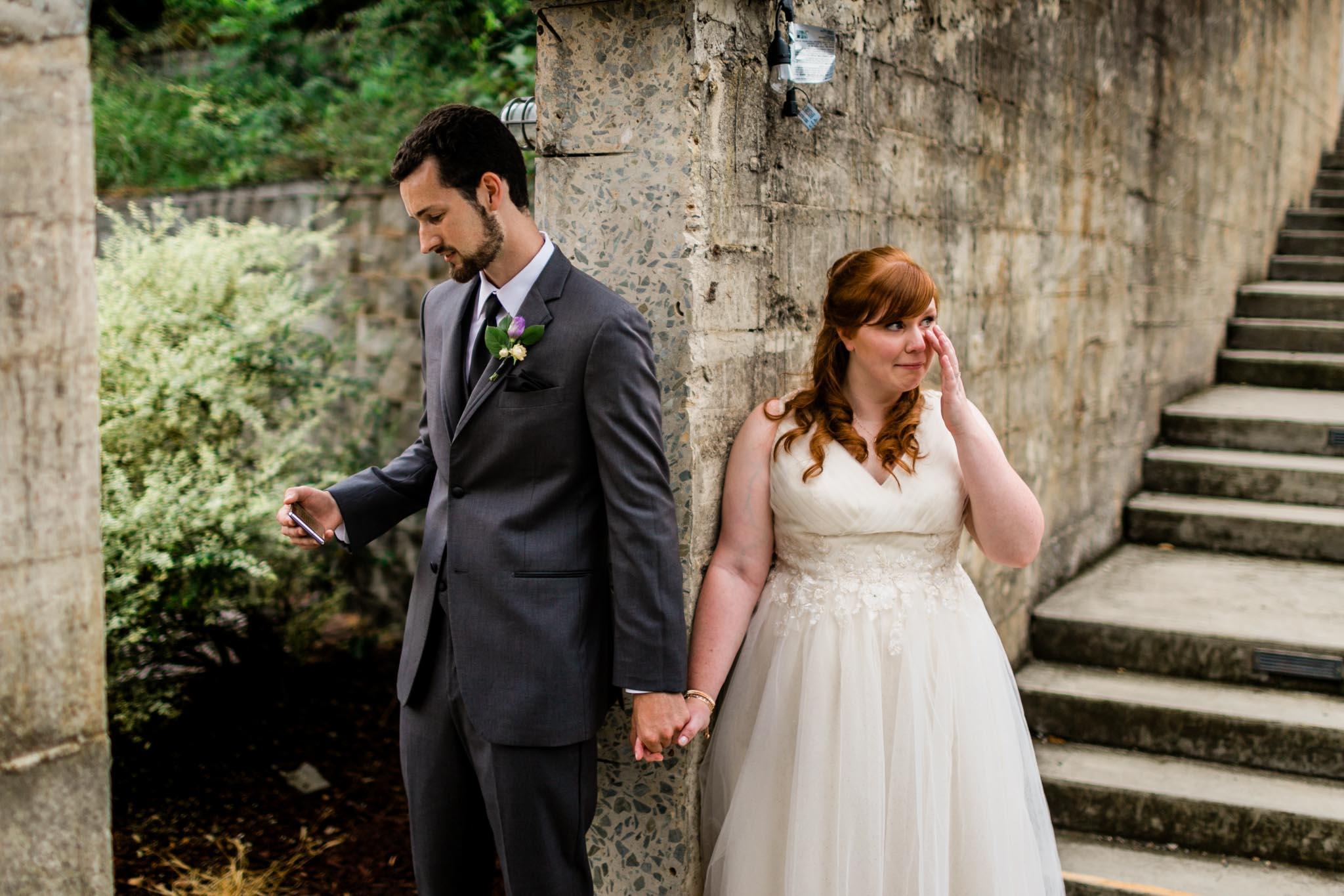 Couple saying prayer before ceremony   Haw River Ballroom Wedding   By G. Lin Photography   Durham Wedding Photographer