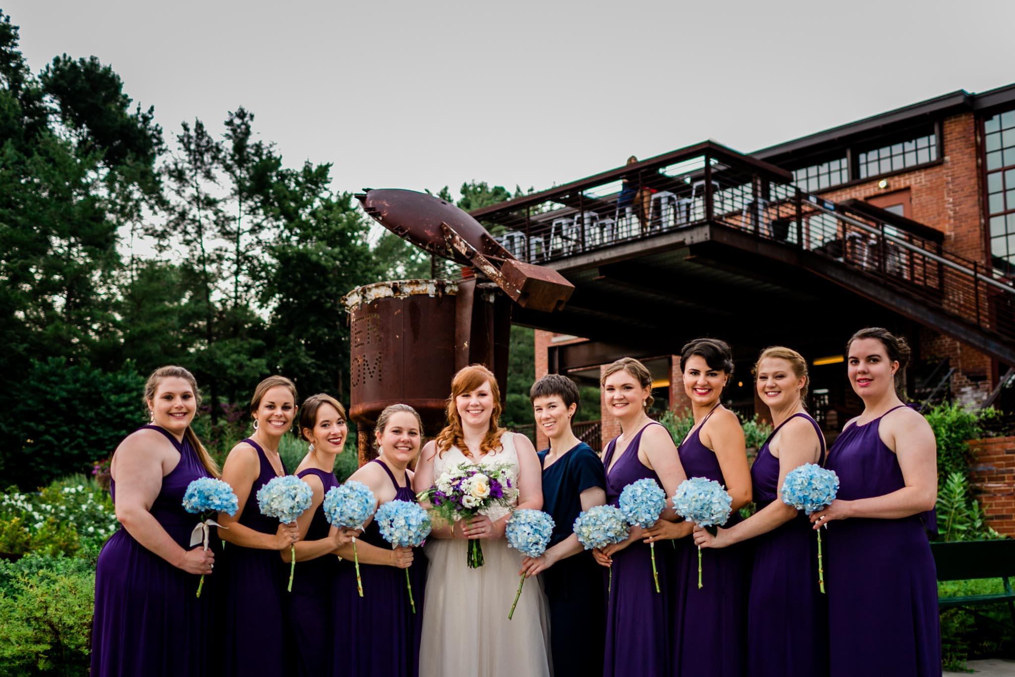 Bride with bridesmaids portrait   Haw River Ballroom Wedding   By G. Lin Photography   Durham Wedding Photographer