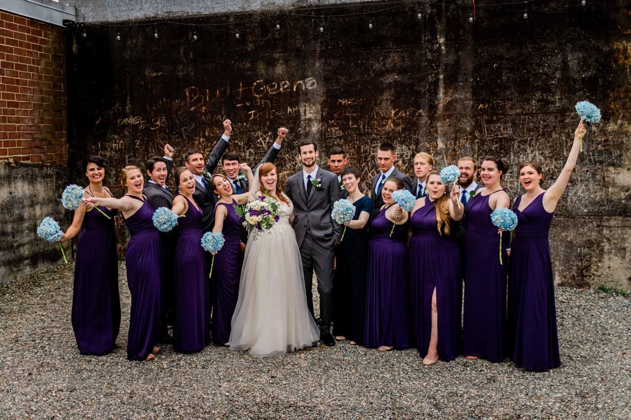 Haw River Ballroom Wedding   Durham Wedding Photographer   By G. Lin Photography   Wedding party cheering