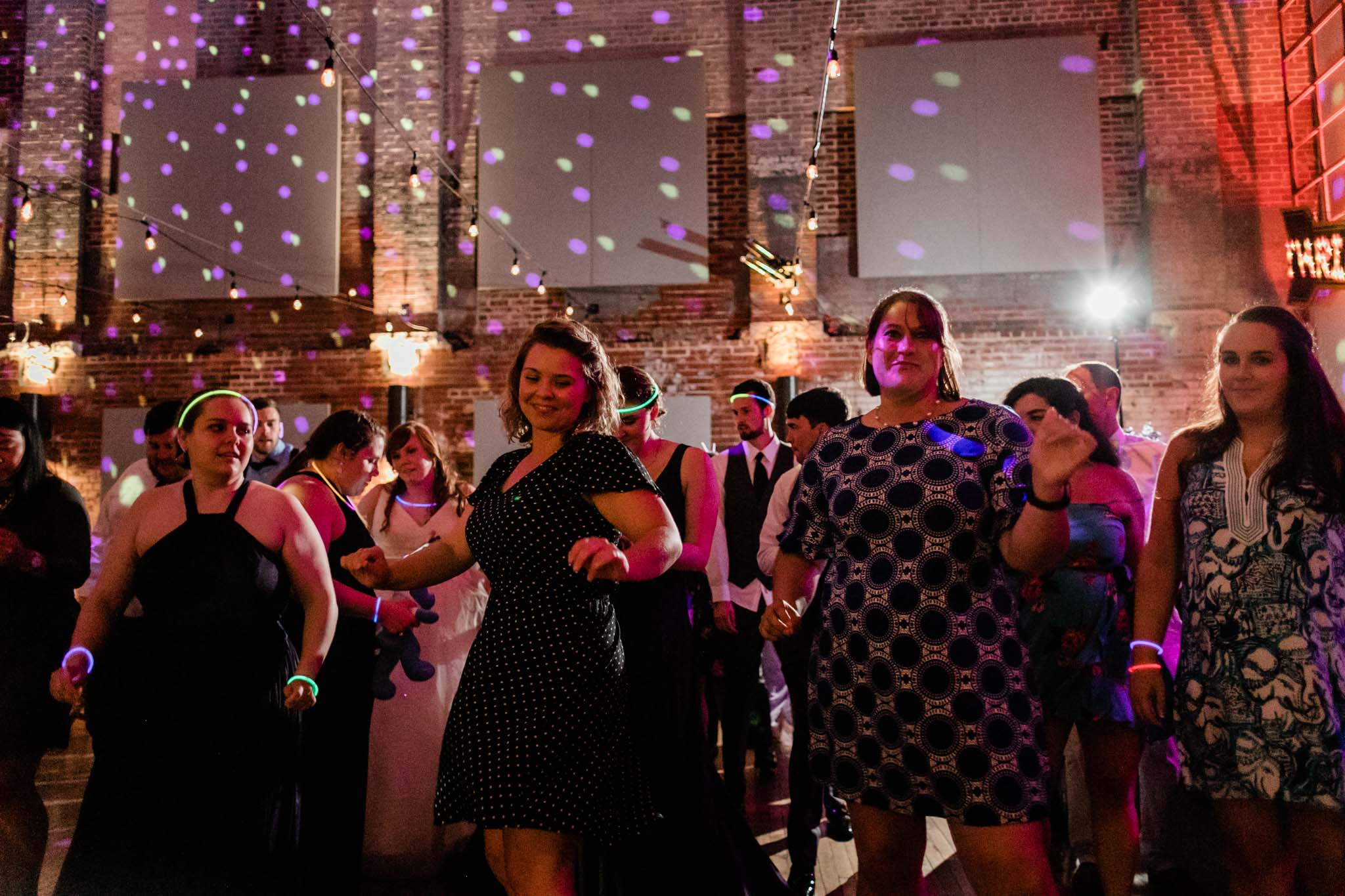 Haw River Ballroom Wedding | Durham Wedding Photographer | By G. Lin Photography | Women dancing at wedding reception