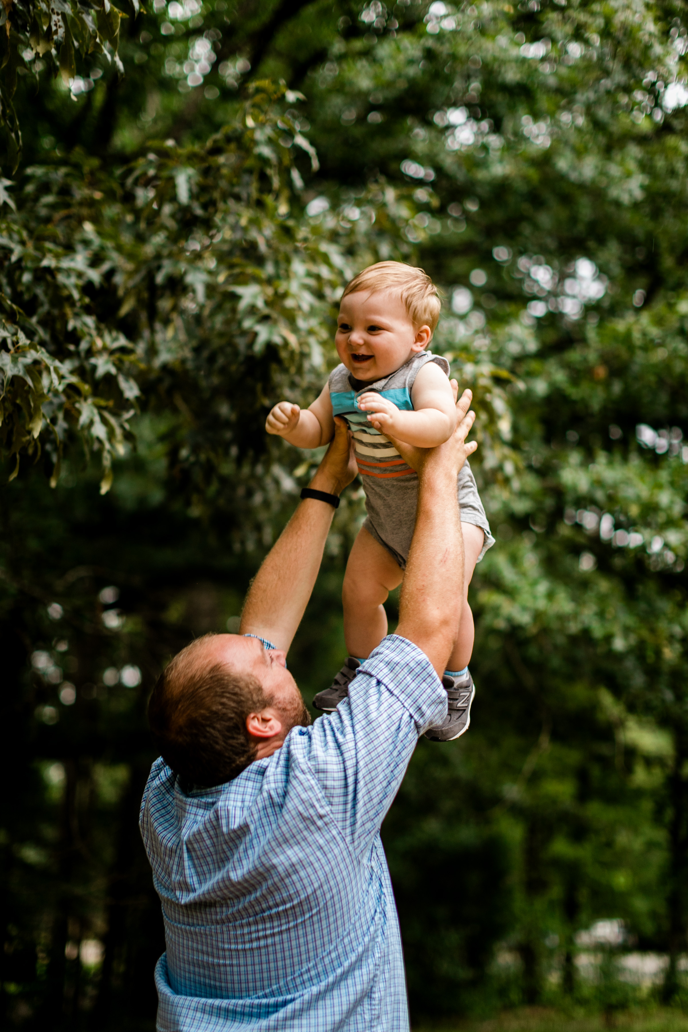 Durham Family Photographer | By G. Lin Photography | Outdoor portraits at Spruce Pine Lodge | Dad throwing son in the air