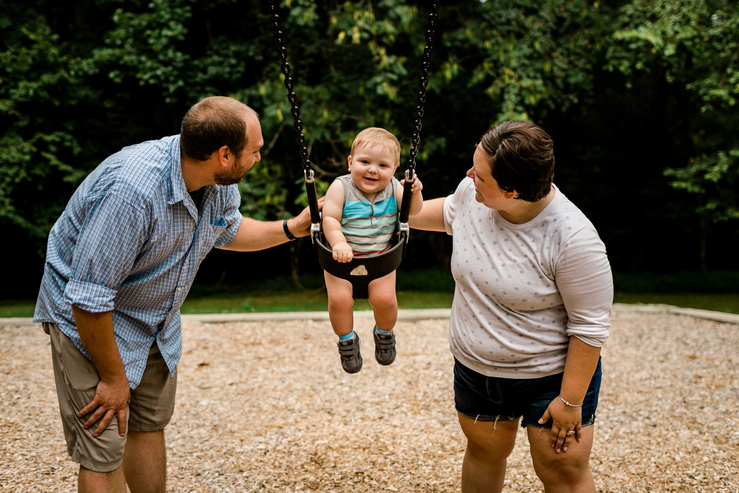 Baby boy swinging with parents | Durham Family Photographer | By G. Lin Photography