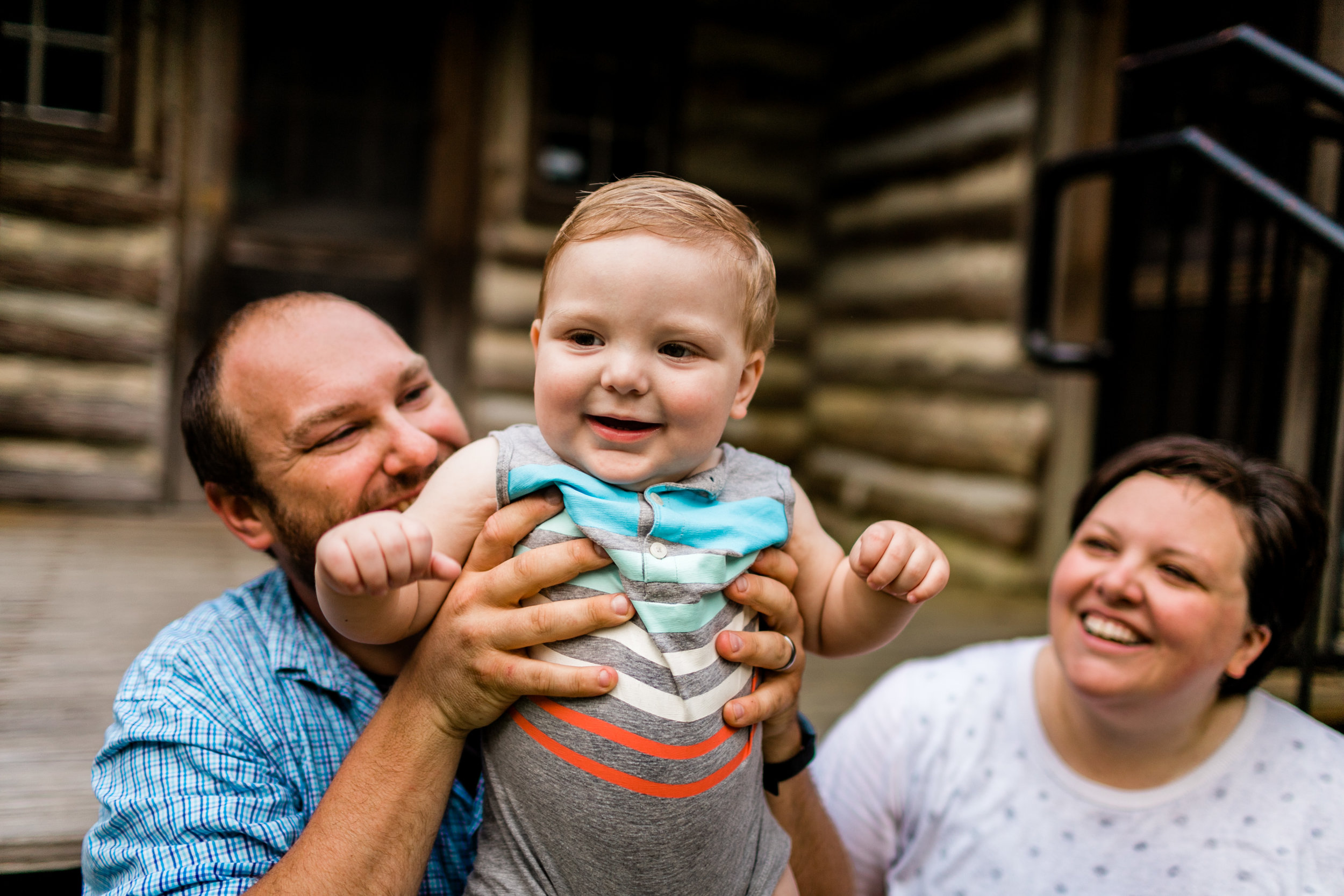 Durham Family Photographer | By G. Lin Photography | Baby boy smiling with parents in the background | Spruce Pine Lodge Bahama NC