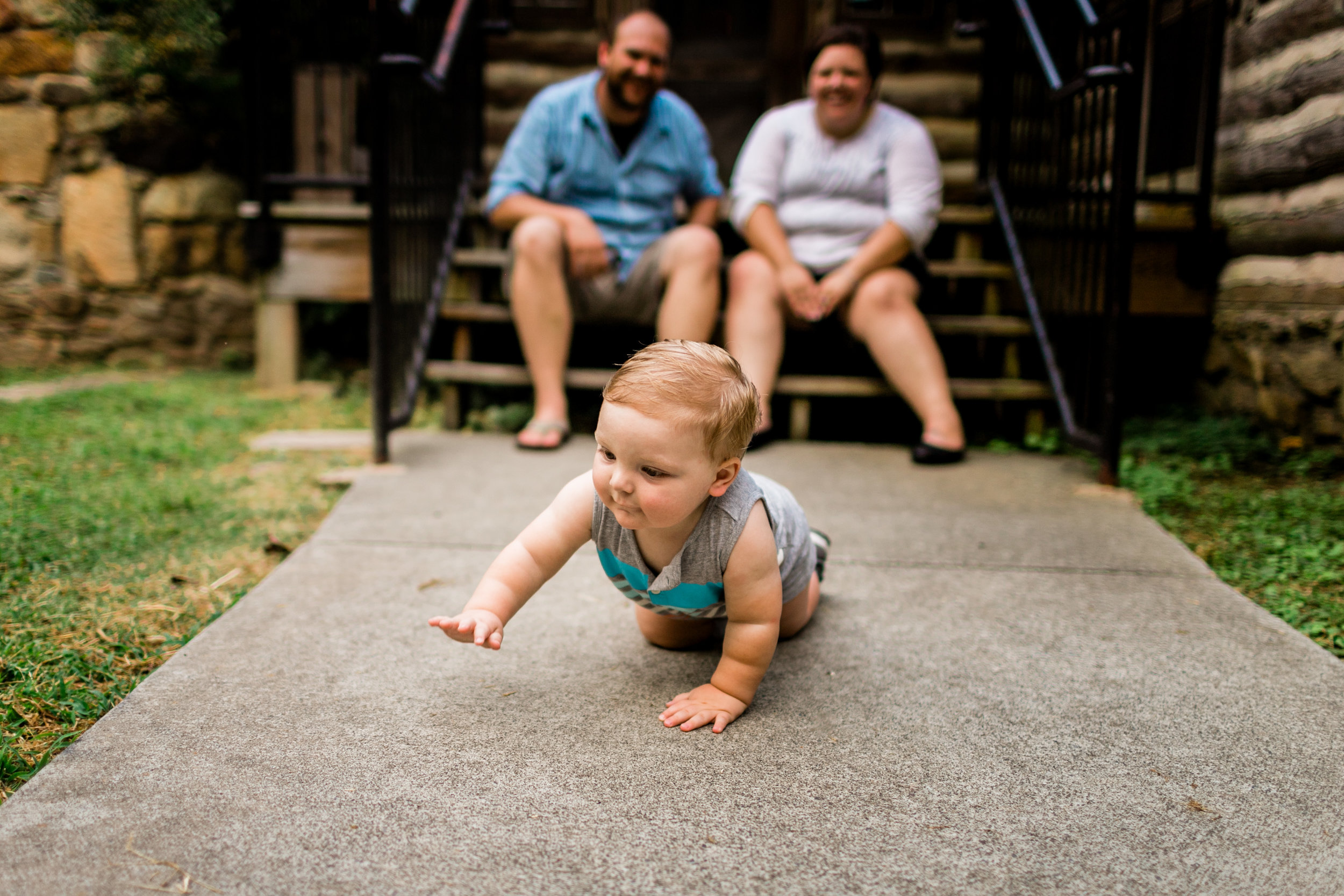 Baby crawling on ground | Portraits at Spruce Pine Lodge | Durham Family Photographer | By G. Lin Photography
