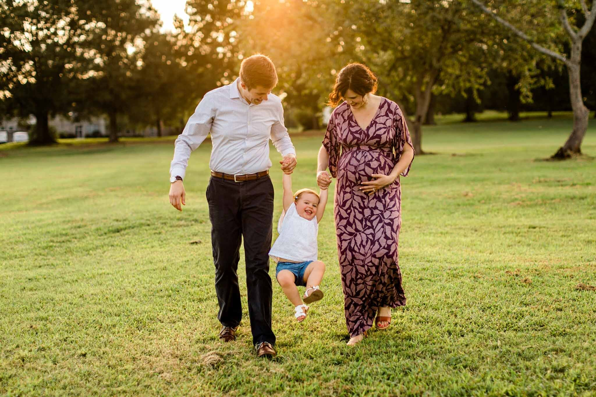 Raleigh Family Photographer | By G. Lin Photography | Family walking outside at Dix Park at sunset