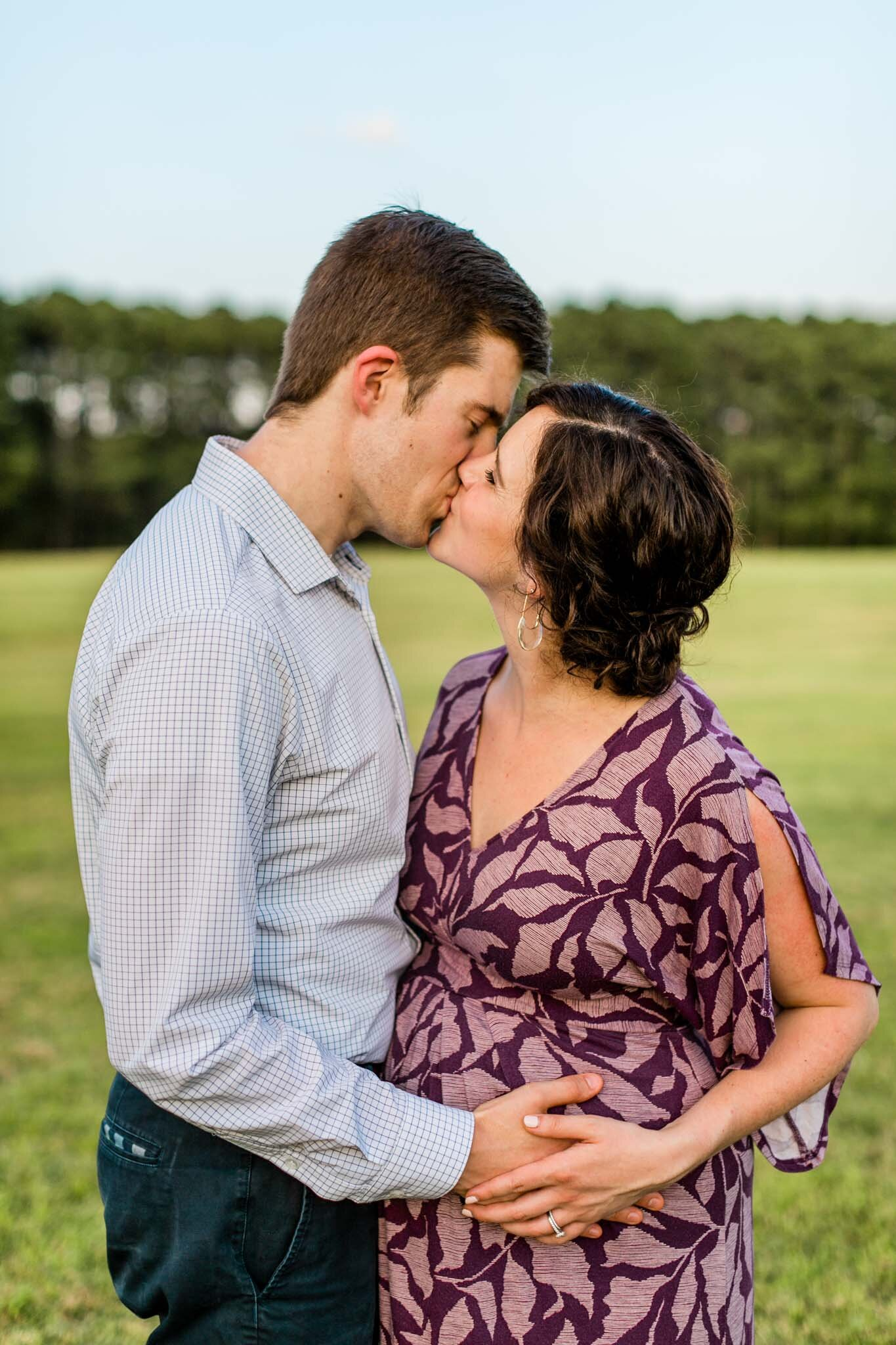 Raleigh Family Photographer | By G. Lin Photography | Couple kissing in open field at Dix Park
