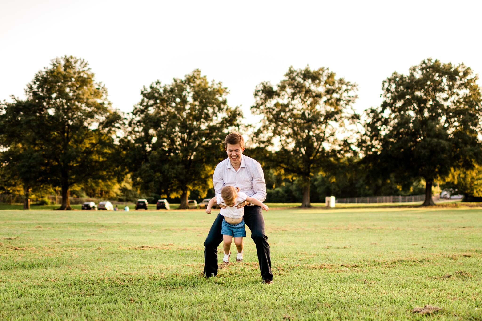Raleigh Family Photography at Dix Park | By G. Lin Photography | Dad playing with daughter in open field
