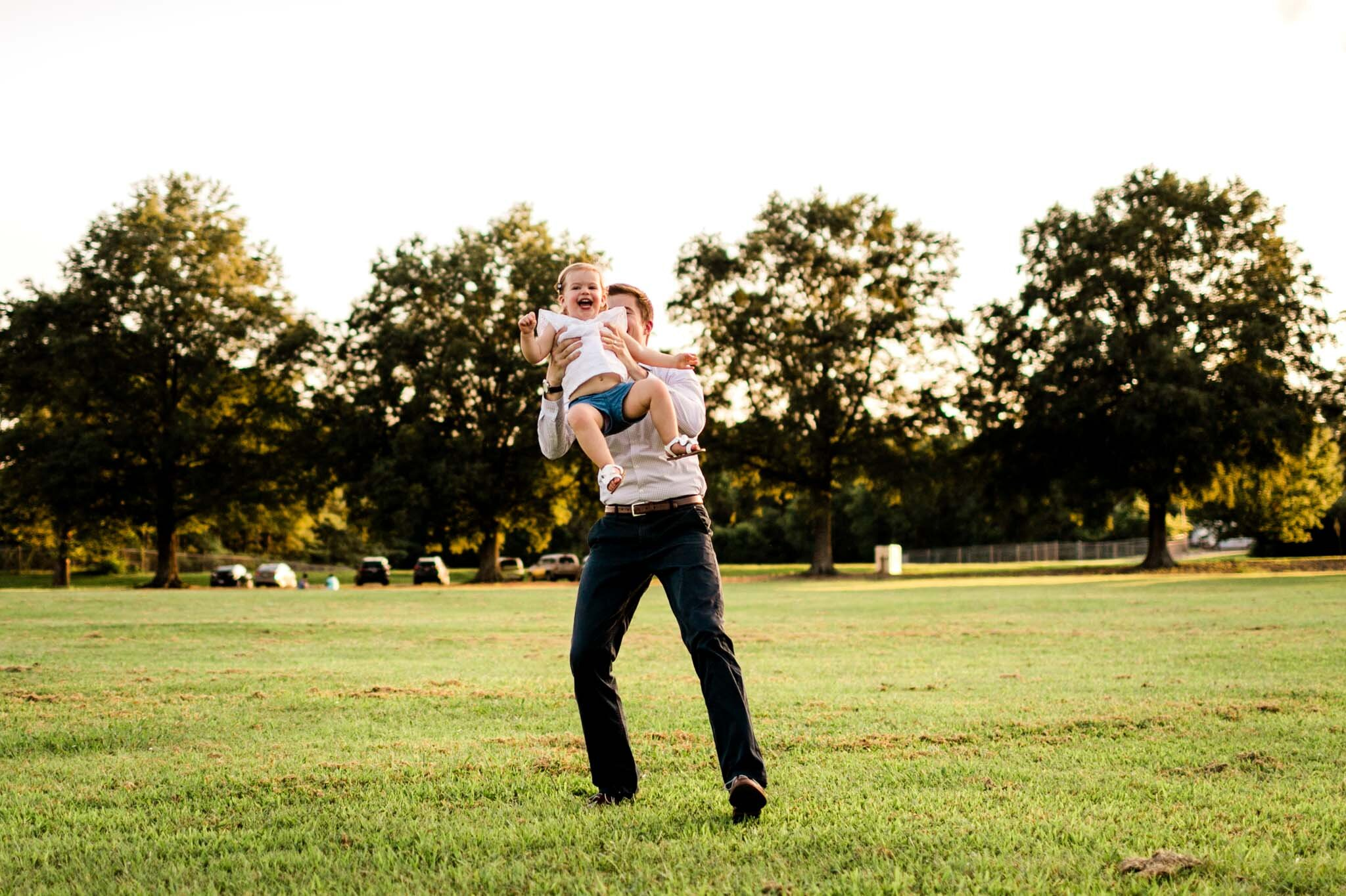 Raleigh Family Photography at Dix Park | By G. Lin Photography | Dad throwing daughter in the air