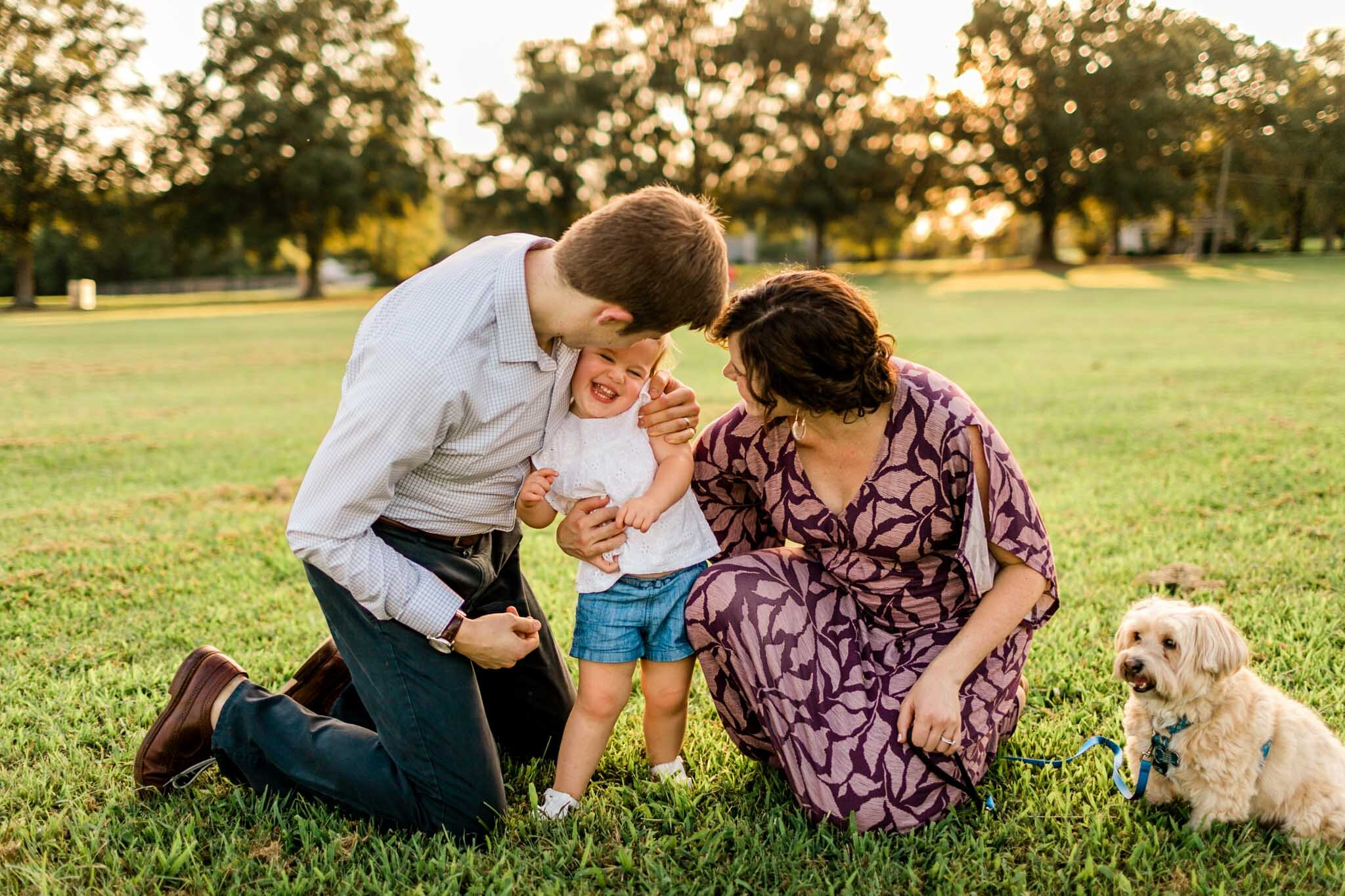 Raleigh Family Photographer at Dix Park | By G. Lin Photography | Group photos of family in open field laughing
