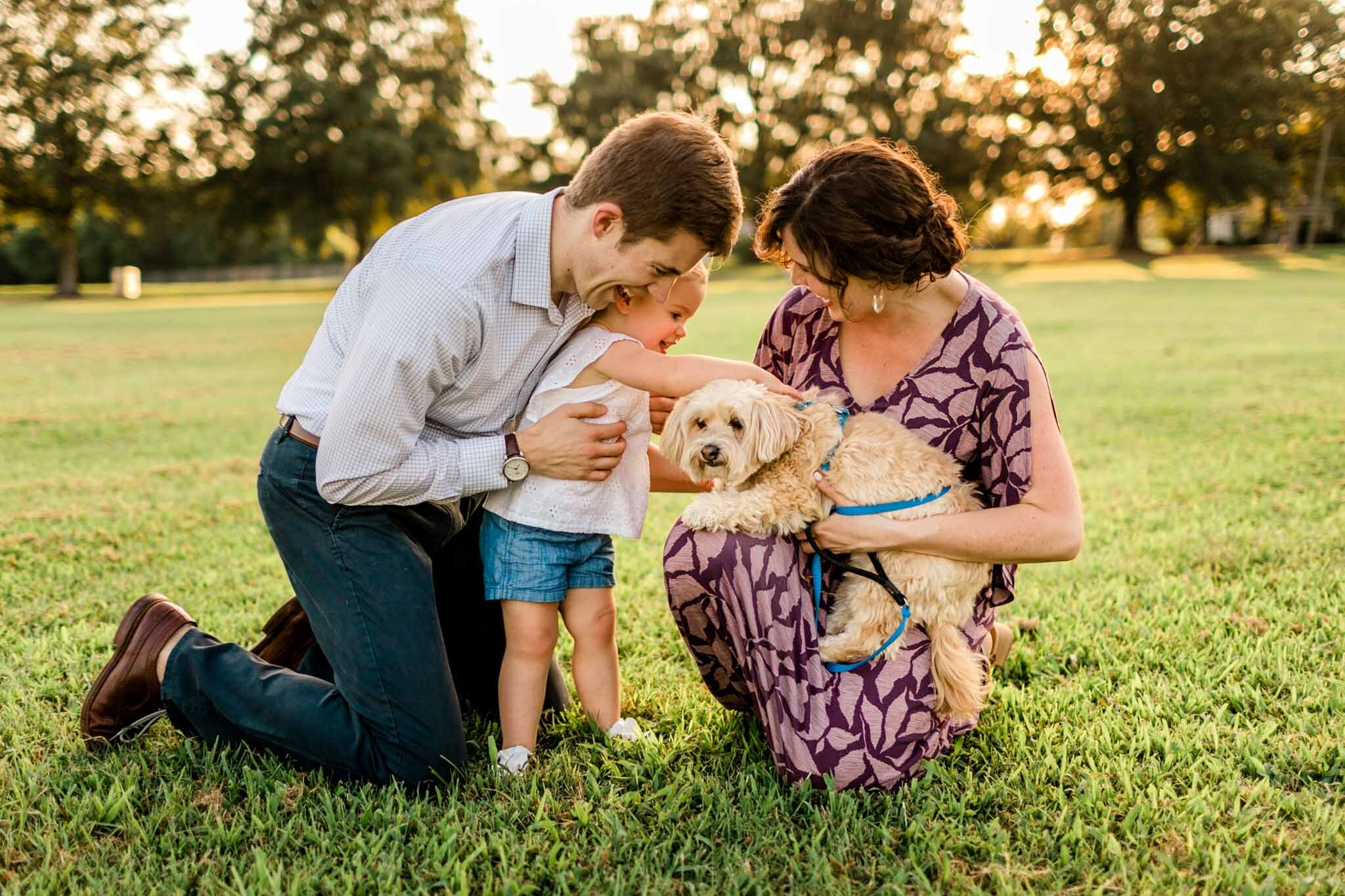 Family laughing together outside | Family Photography at Dix Park Raleigh | By G. Lin Photography