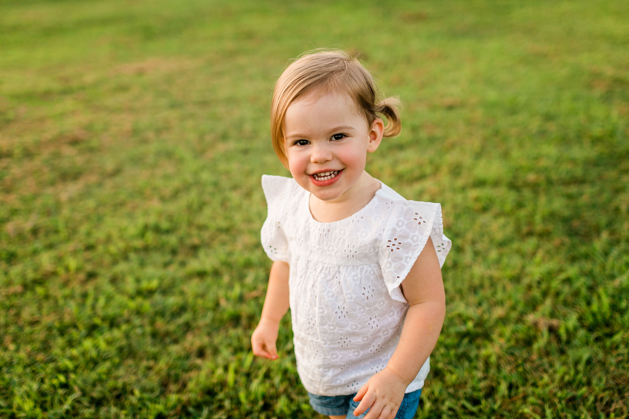 Raleigh Family Photographer | By G. Lin Photography | Dorothea Dix Park | Girl smiling at camera