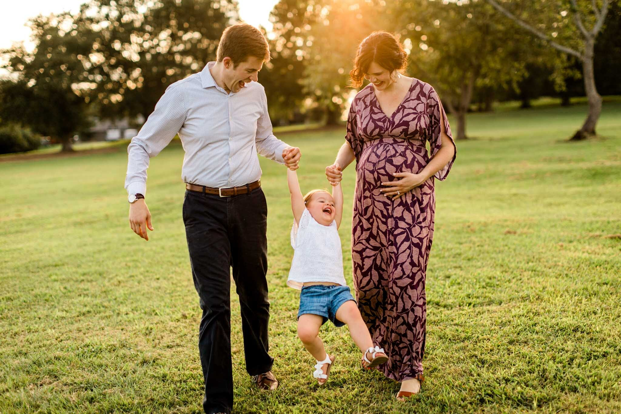 Raleigh Family Photographer | By G. Lin Photography | Family smiling and laughing together swinging little girl