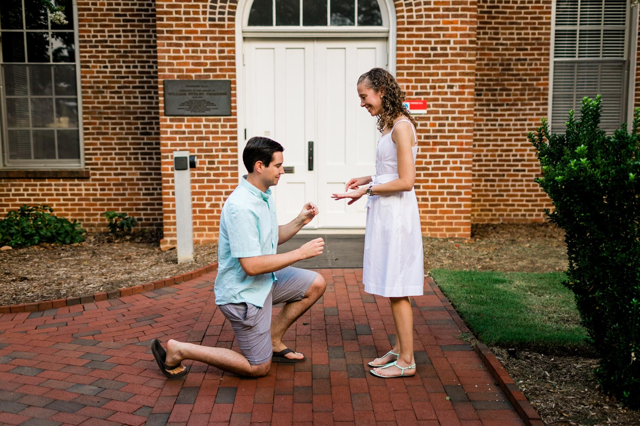 Raleigh Engagement Photographer | NC State University | By G. Lin Photography | Man offering engagement ring to woman