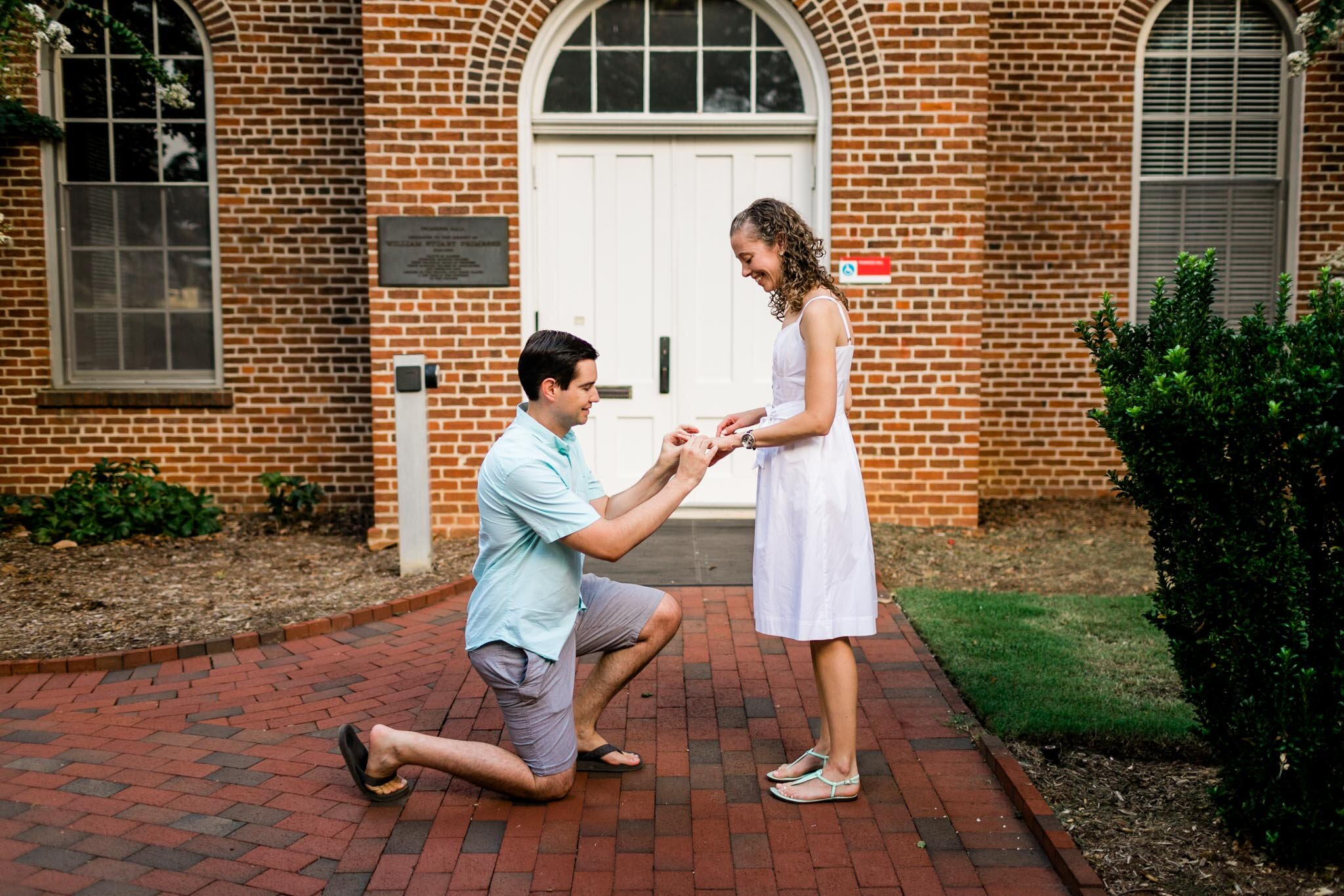 Raleigh Engagement Photographer | NC State University | By G. Lin Photography | Man putting engagement ring on woman