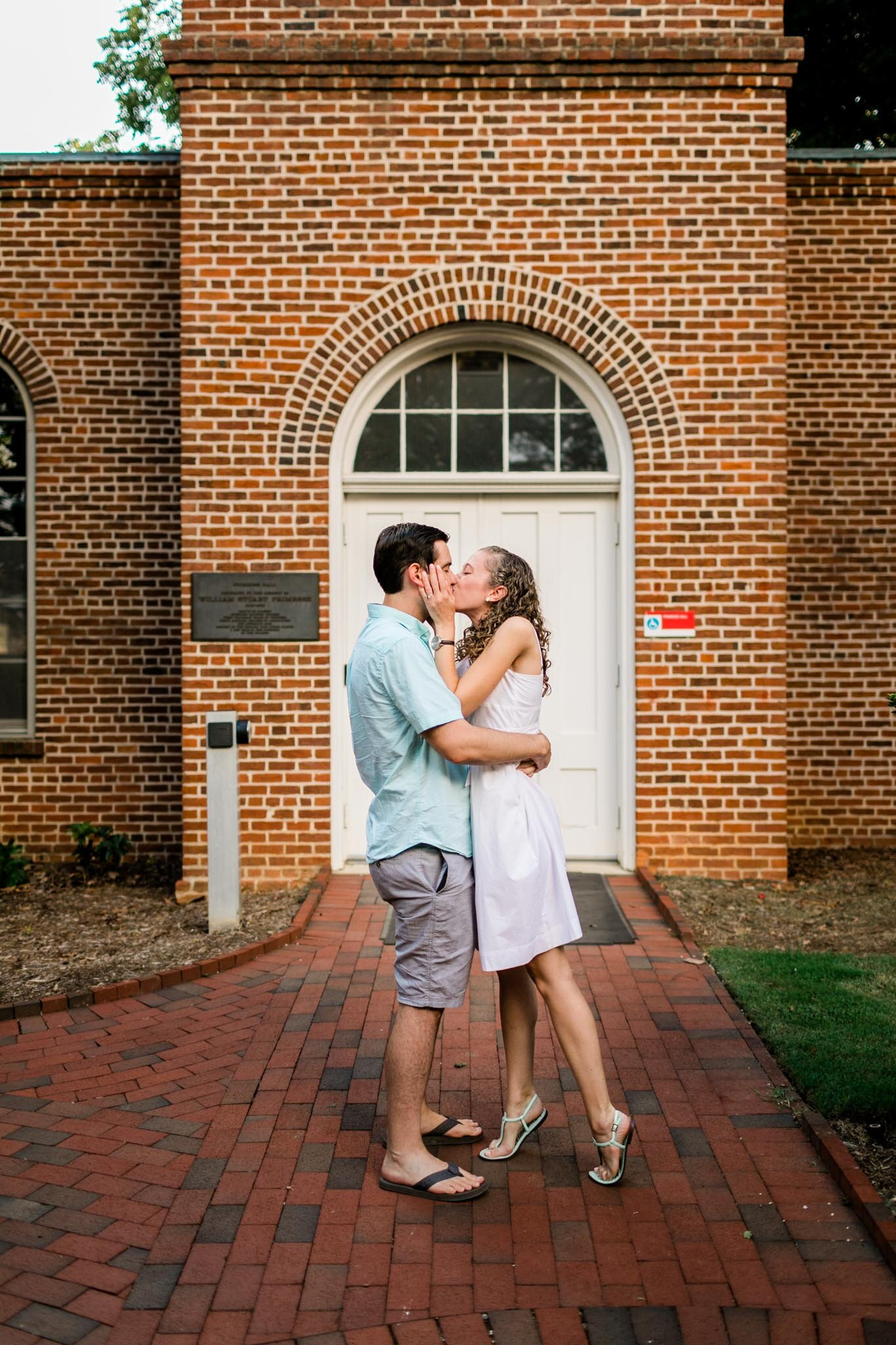 Raleigh Engagement Photographer | NC State University | By G. Lin Photography | Couple kissing after proposal
