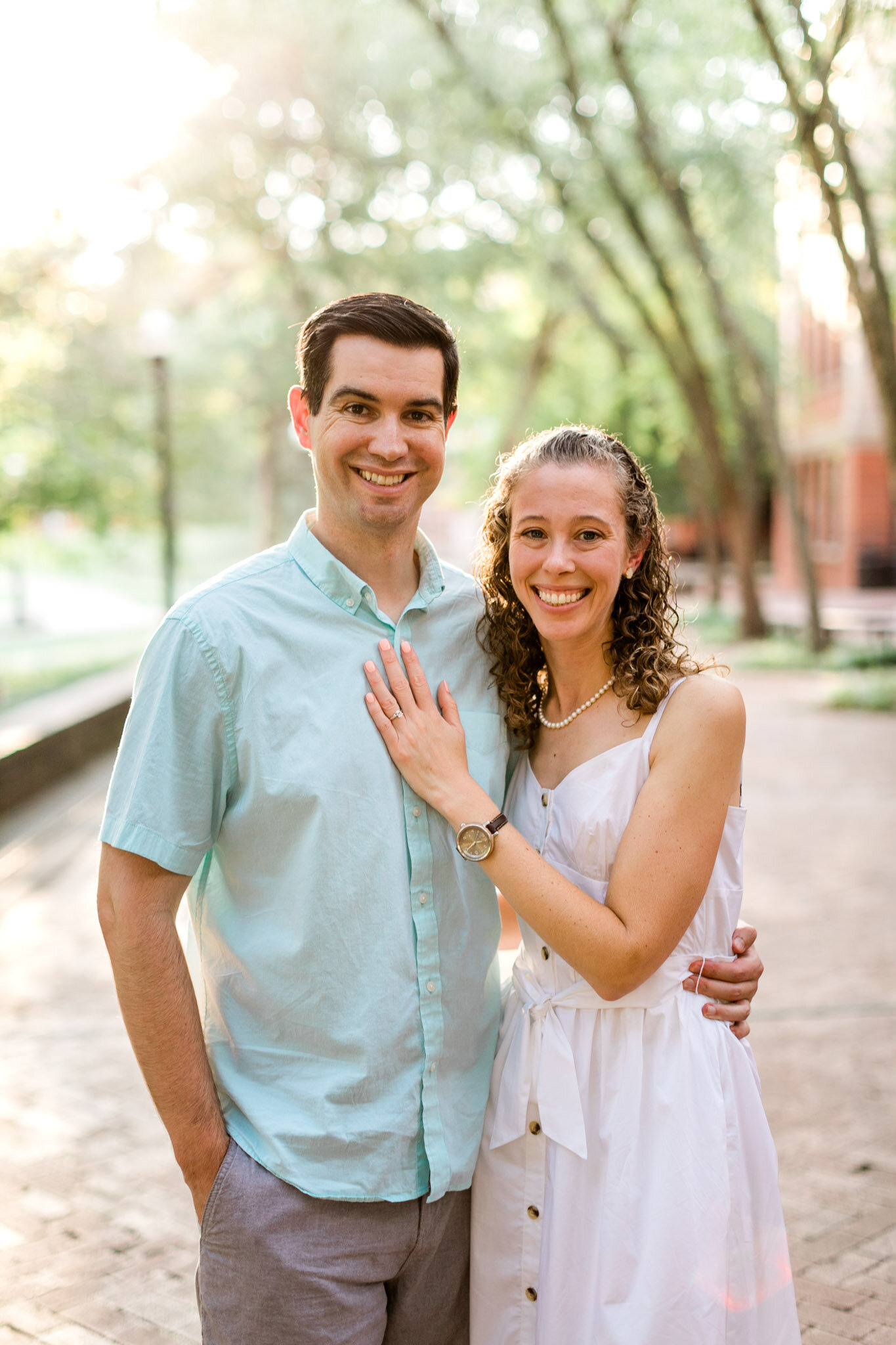 Raleigh Engagement Photographer | NC State University | By G. Lin Photography | Couple smiling in front of camera