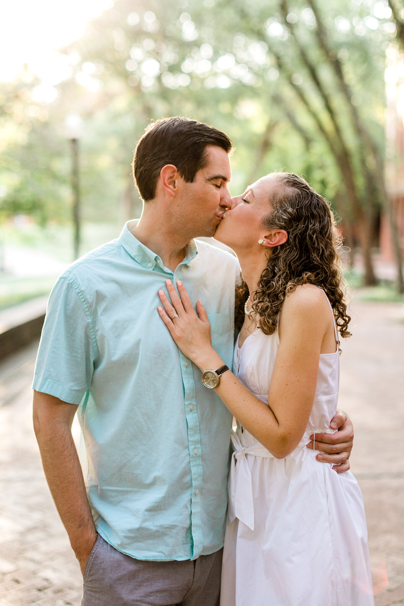 Raleigh Engagement Photographer | NC State University | By G. Lin Photography | Couple kissing outdoors during golden hour