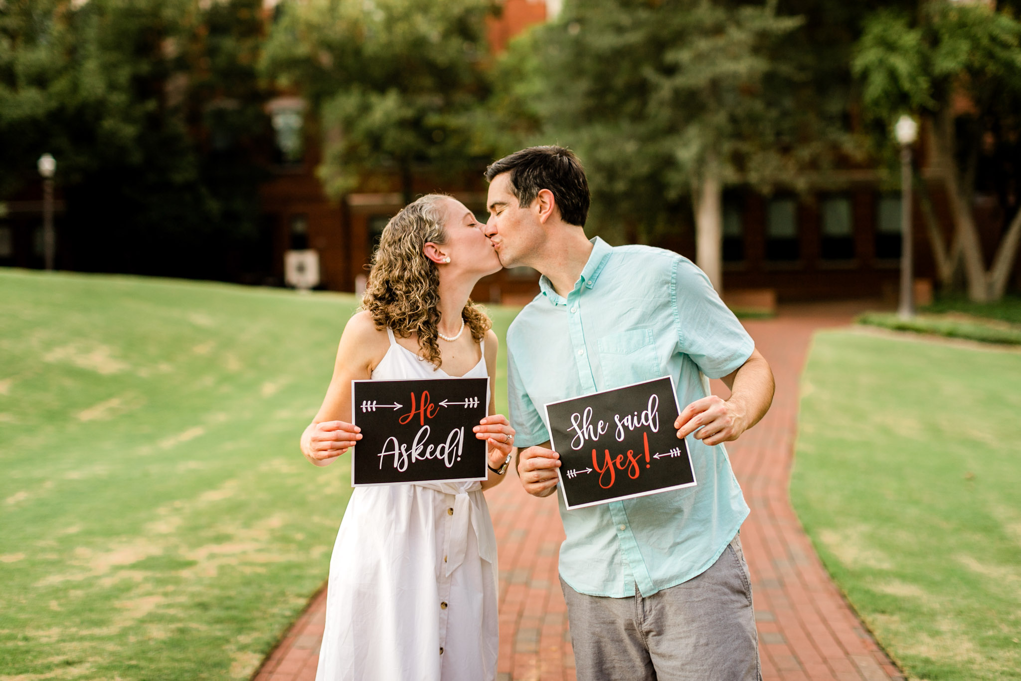 Raleigh Engagement Photographer | NC State University | By G. Lin Photography | He asked she said yes with couple kissing