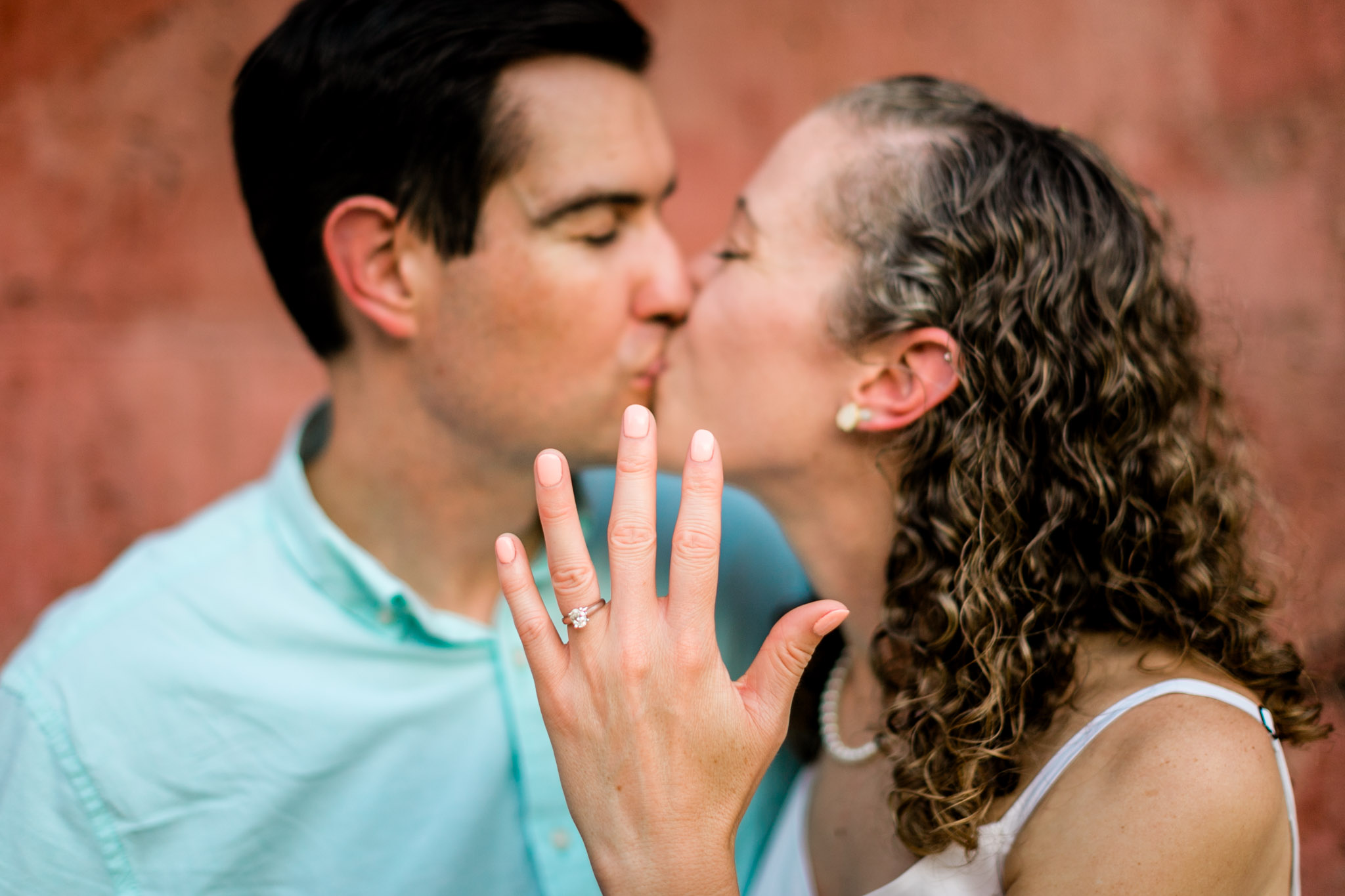 Raleigh Engagement Photographer | NC State University | By G. Lin Photography | Woman holding hand up with engagement ring