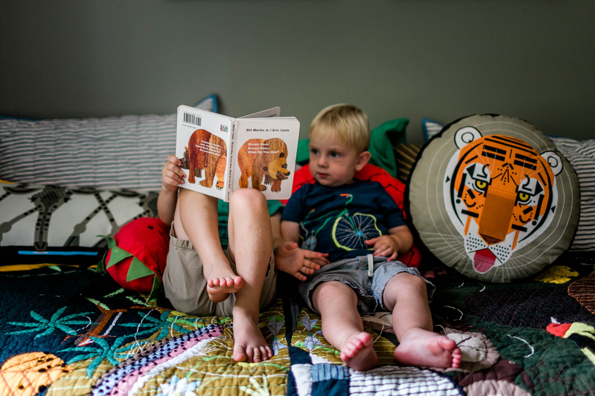Durham Newborn Photographer | By G. Lin Photography | Older brother reading book to sibling