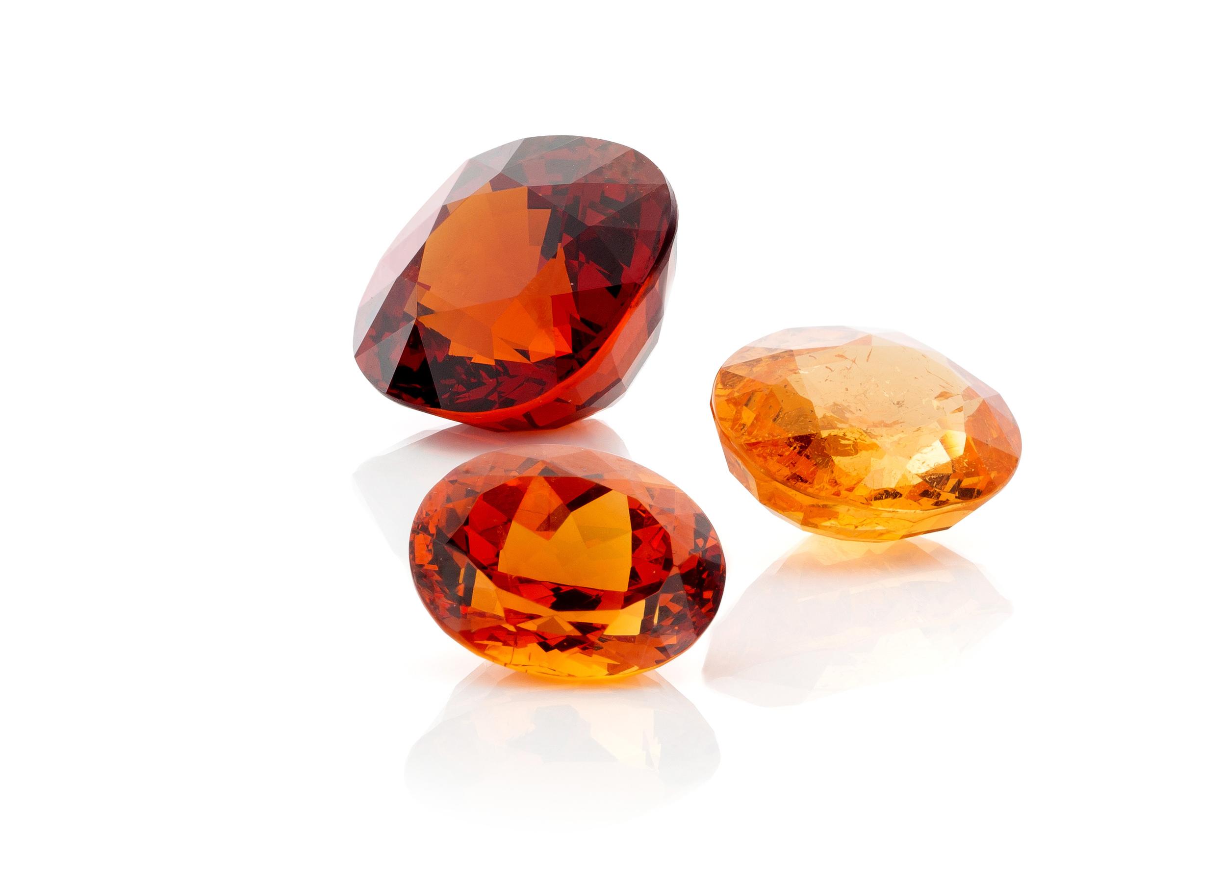 Mandarin garnets - some of our stock items - vivid , bright and fanta orange Spessartine