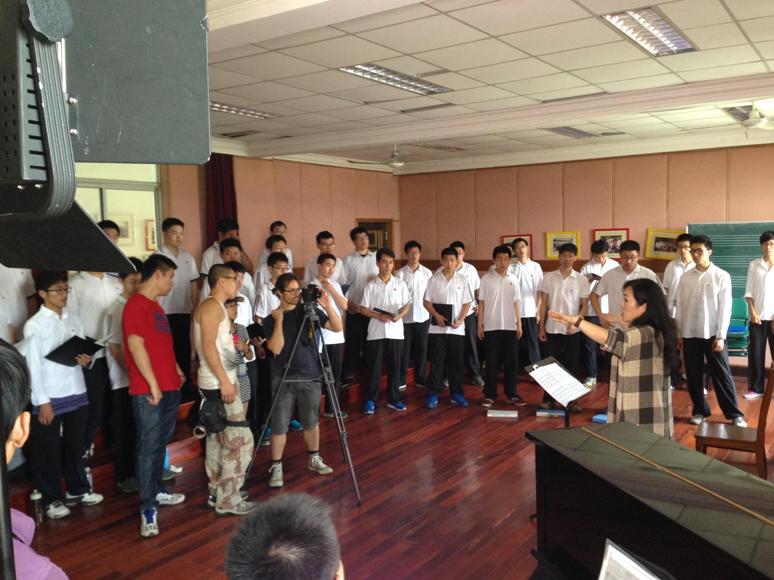 Choir rehearsing with teacher Liu.