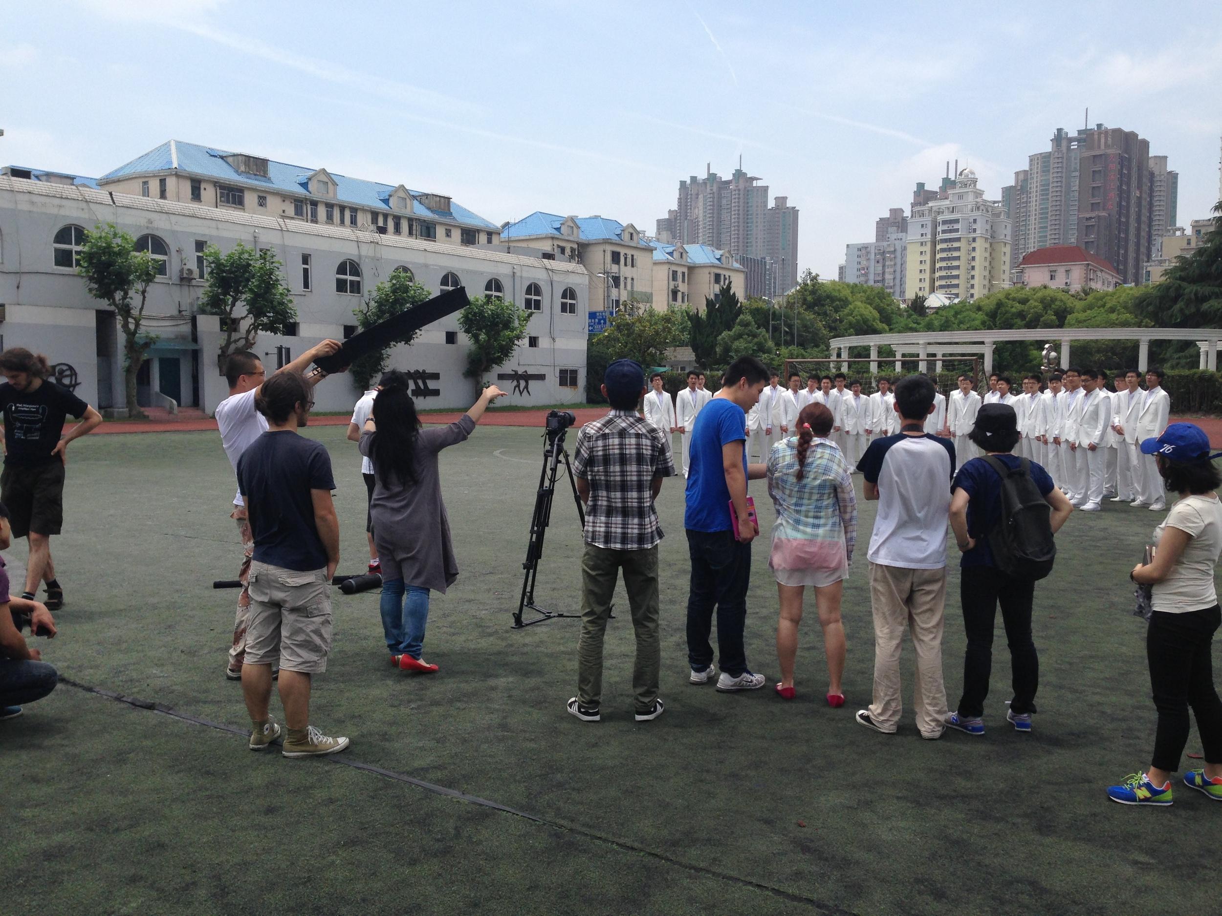 Shooting the choir singing on campus of Yangjing High School.