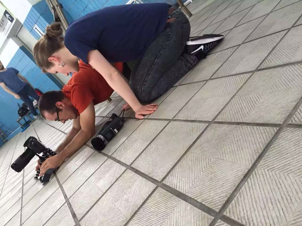 Setting up a close shot at the swimming pool with director Antonia Meile.