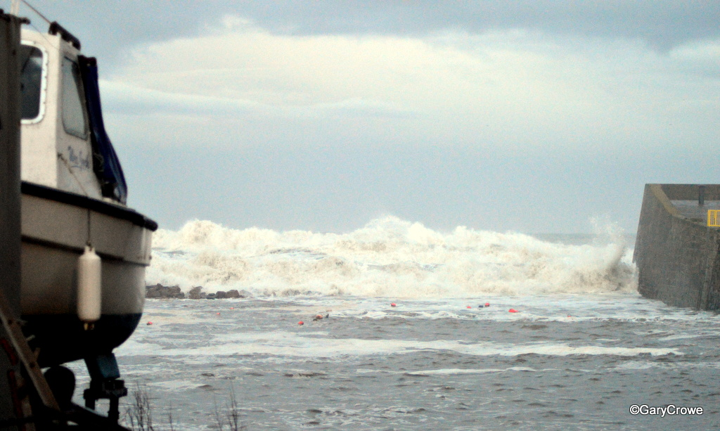 Broadhaven Harbour with the rough sea crashing over the back wall.
