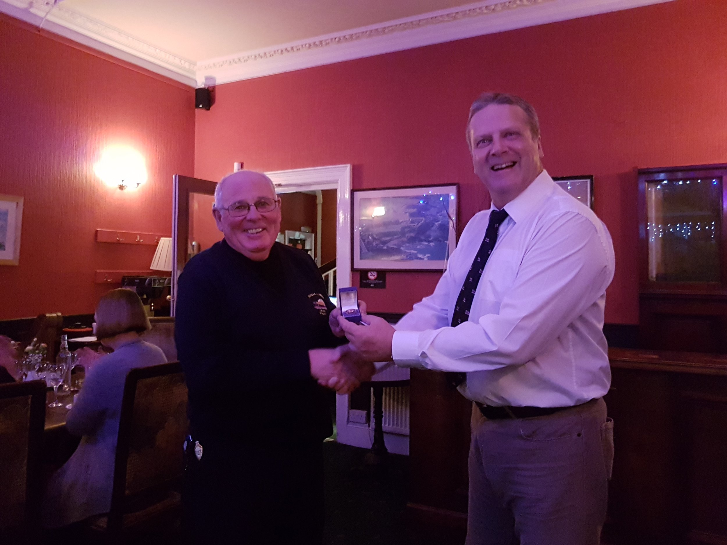 Mike on the left being presented his long service medal by Dave Anderson the lifeboat operations manager at Dunbar.