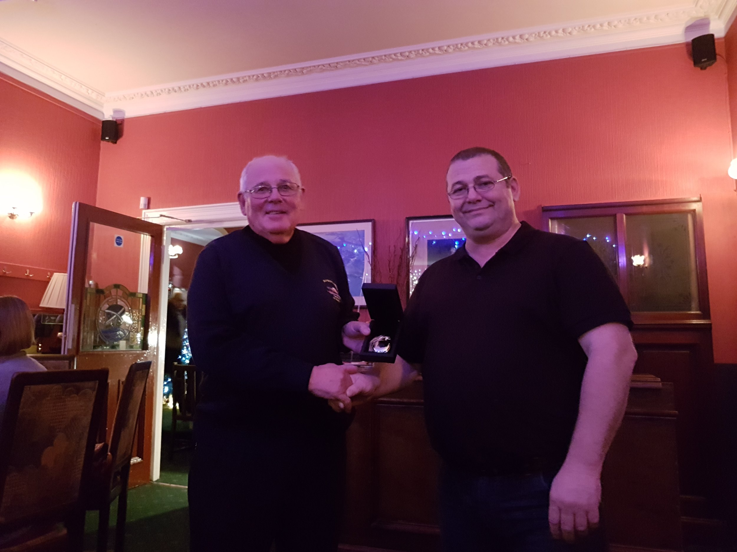 Coxswain Gary Fairbairn presents Mike with his gift and thanks him for his time and work over the years.
