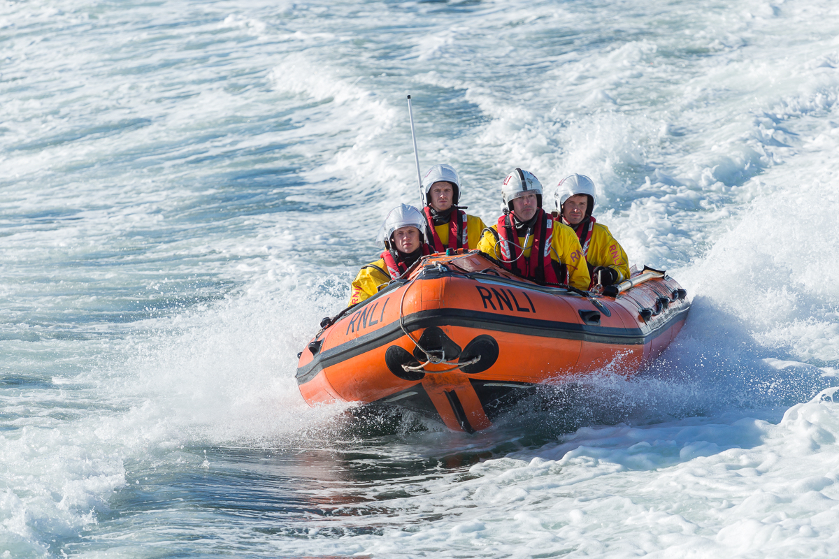 Kieran (left) gets a taste of life on the D-class inshore lifeboat (ILB) (photo: Nick Mailer)