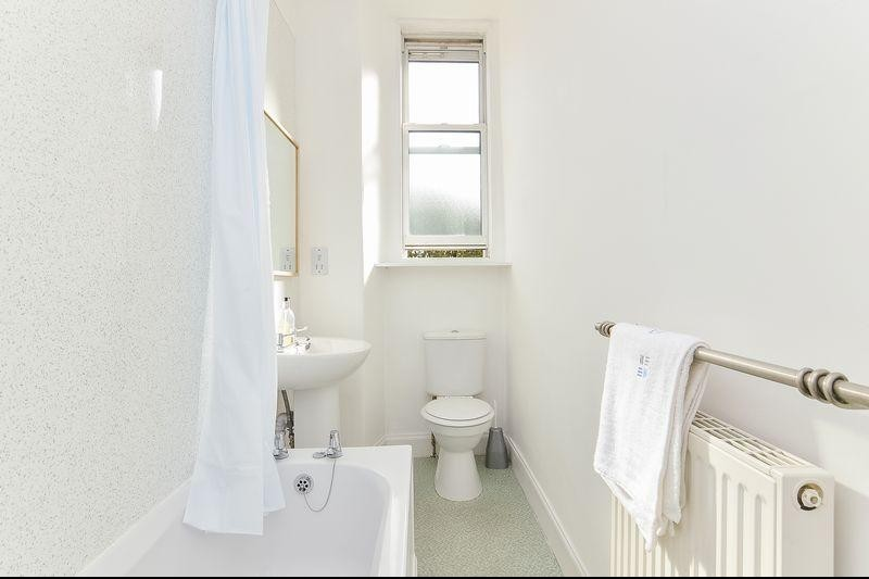 A photo of the old bathroom, taken from the from the original listing.