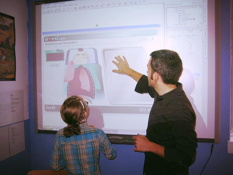 A teacher makes use of an interactive whiteboard